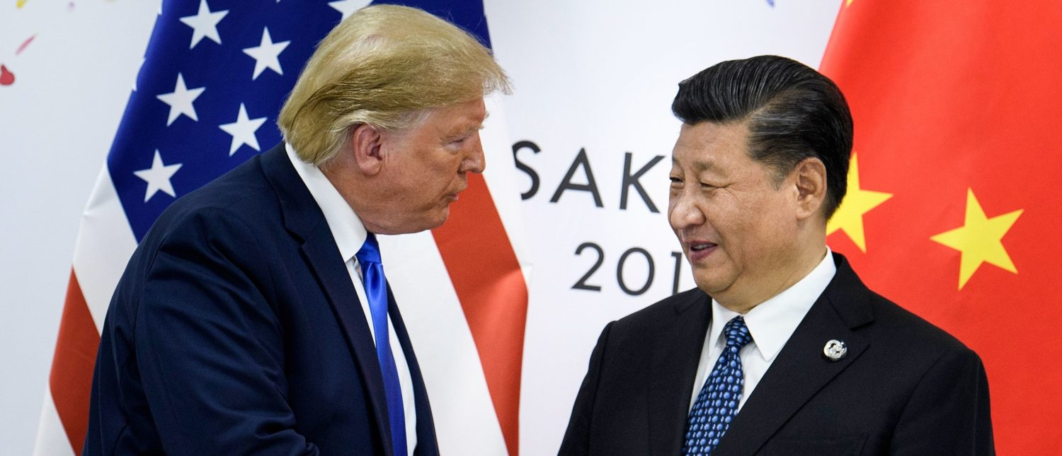 China's President Xi Jinping (R) shakes hands with US President Donald Trump before a bilateral meeting on the sidelines of the G20 Summit in Osaka. - From the Arab Spring to bloodletting in Syria, from Obama to Trump, from terror in the streets of Paris to Brexit, the 2010s began with hope for a more equitable world, and end with a slide towards nationalistic populism. (Photo by BRENDAN SMIALOWSKI/AFP via Getty Images)