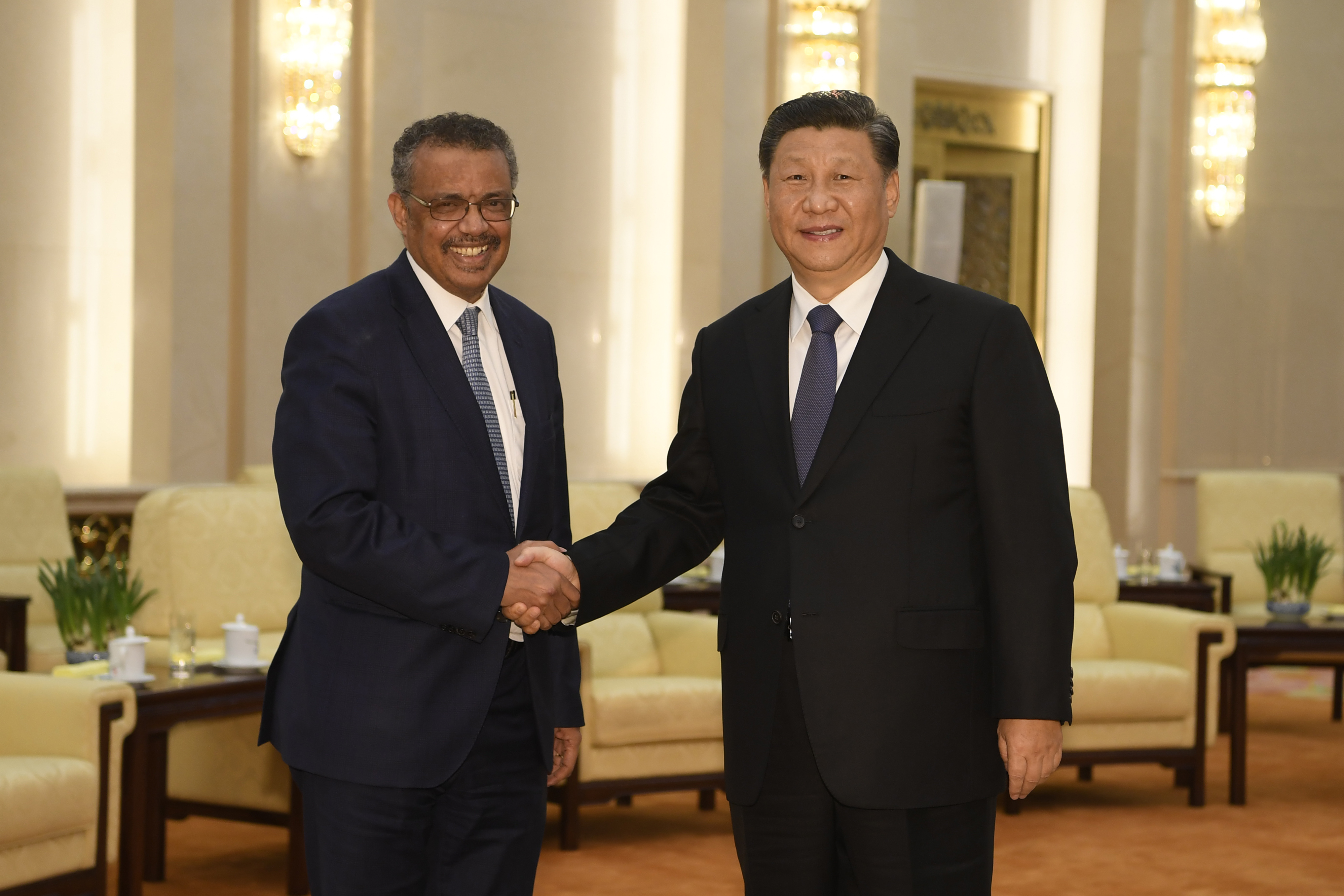 Tedros Adhanom, Director General of the World Health Organization, (L) shakes hands with Chinese President Xi Jinping. (Photo by Naohiko Hatta - Pool/Getty Images)