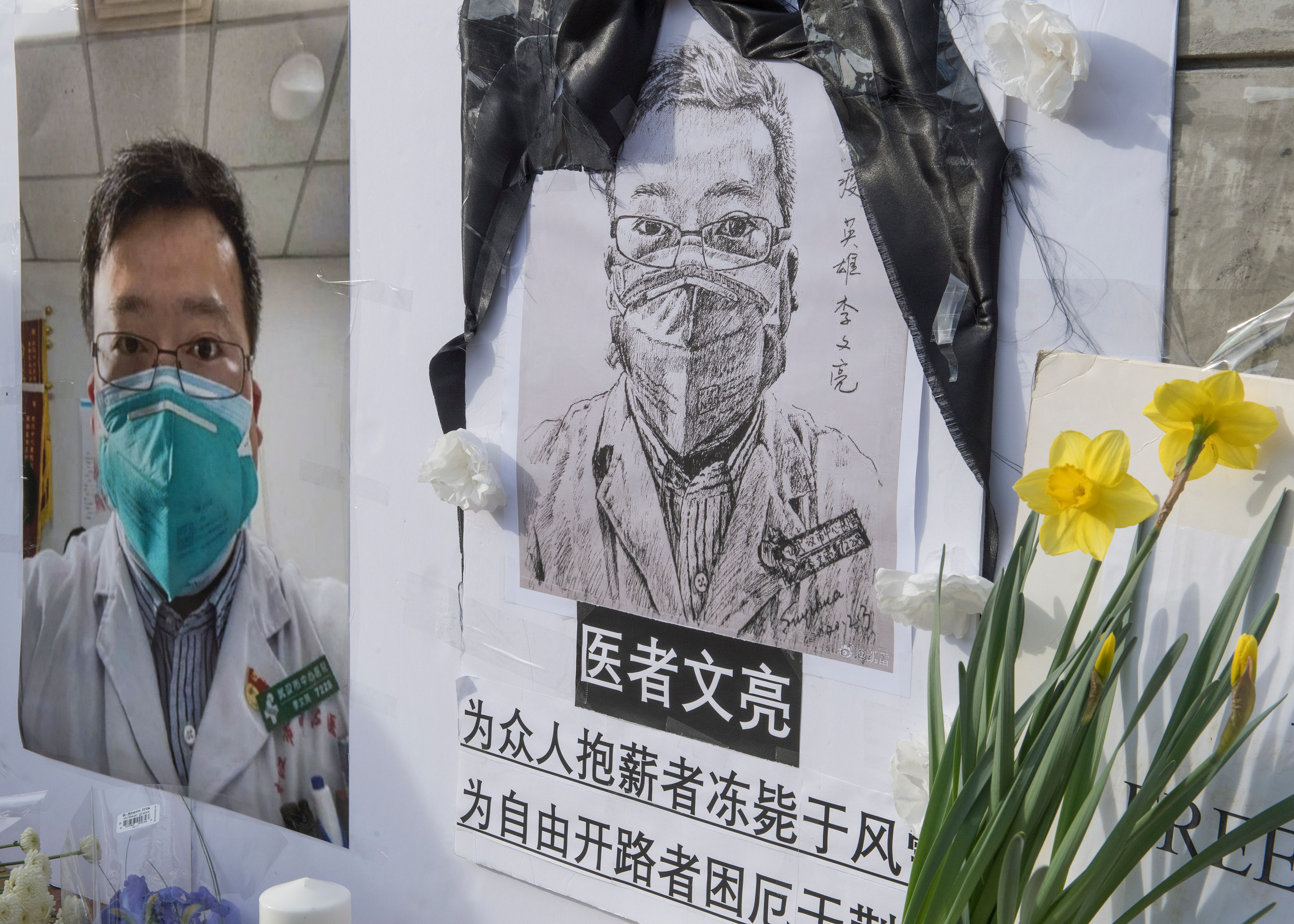 Chinese students and their supporters hold a memorial for Dr Li Wenliang, who was the whistleblower of the Coronavirus, Covid-19, that originated in Wuhan, China. (MARK RALSTON/AFP via Getty Images)