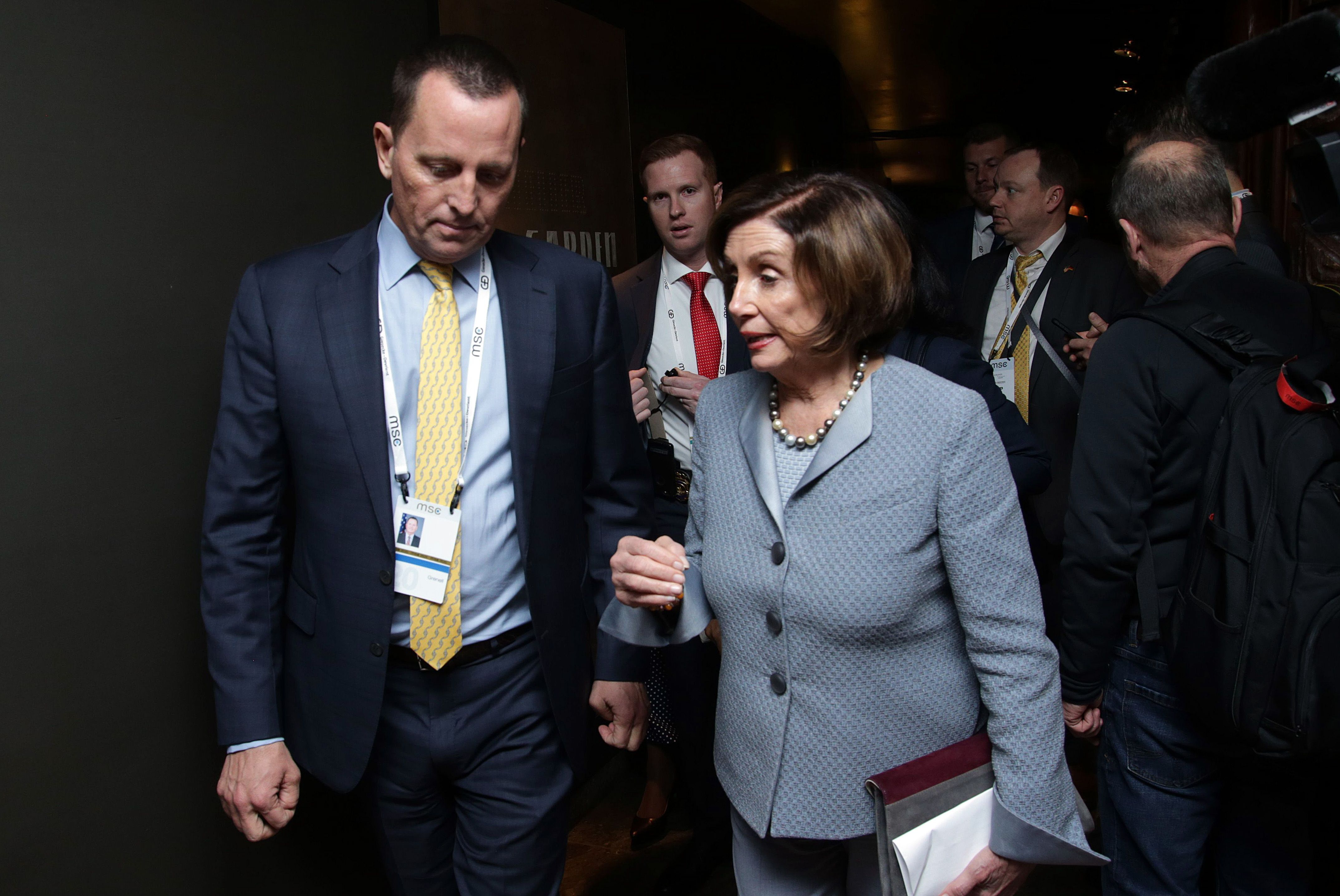MUNICH, GERMANY - FEBRUARY 15: Nancy Pelosi (R), speaker of the US house of representatives and US ambassador to the federal republic of Germany Richard Allen Grenell chat together during the 2020 Munich Security Conference (MSC) on February 15, 2020 in Munich, Germany. The annual conference brings together global political, security and business leaders to discuss pressing issues, which this year include climate change, the US commitment to NATO and the spread of disinformation campaigns. (Photo by Johannes Simon/Getty Images)