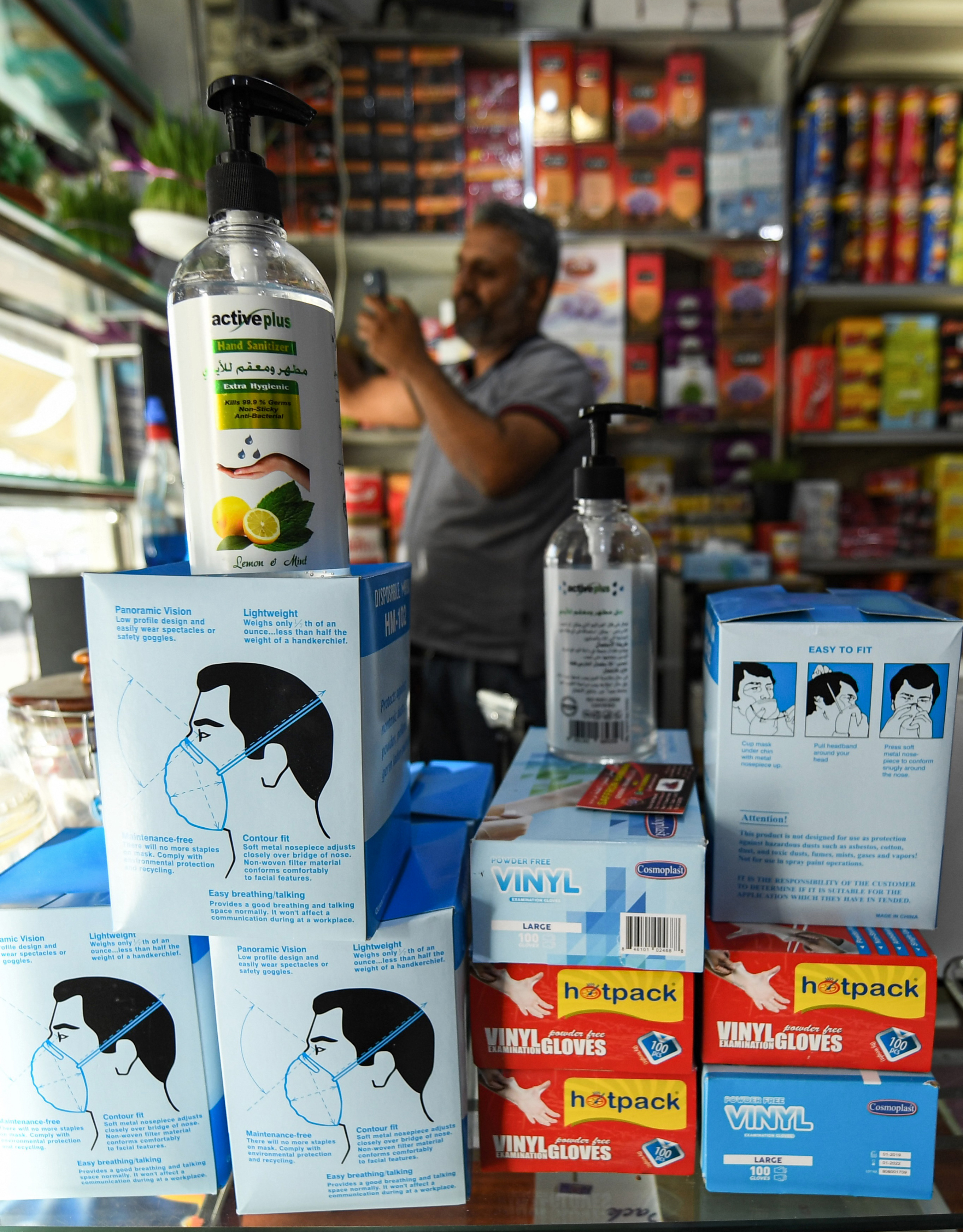 This picture taken on March 20, 2020 shows N95 face masks and hand sanitiser on display at a shop in a market in the centre of the Gulf emirate of Sharjah. (Photo by KARIM SAHIB/AFP via Getty Images)