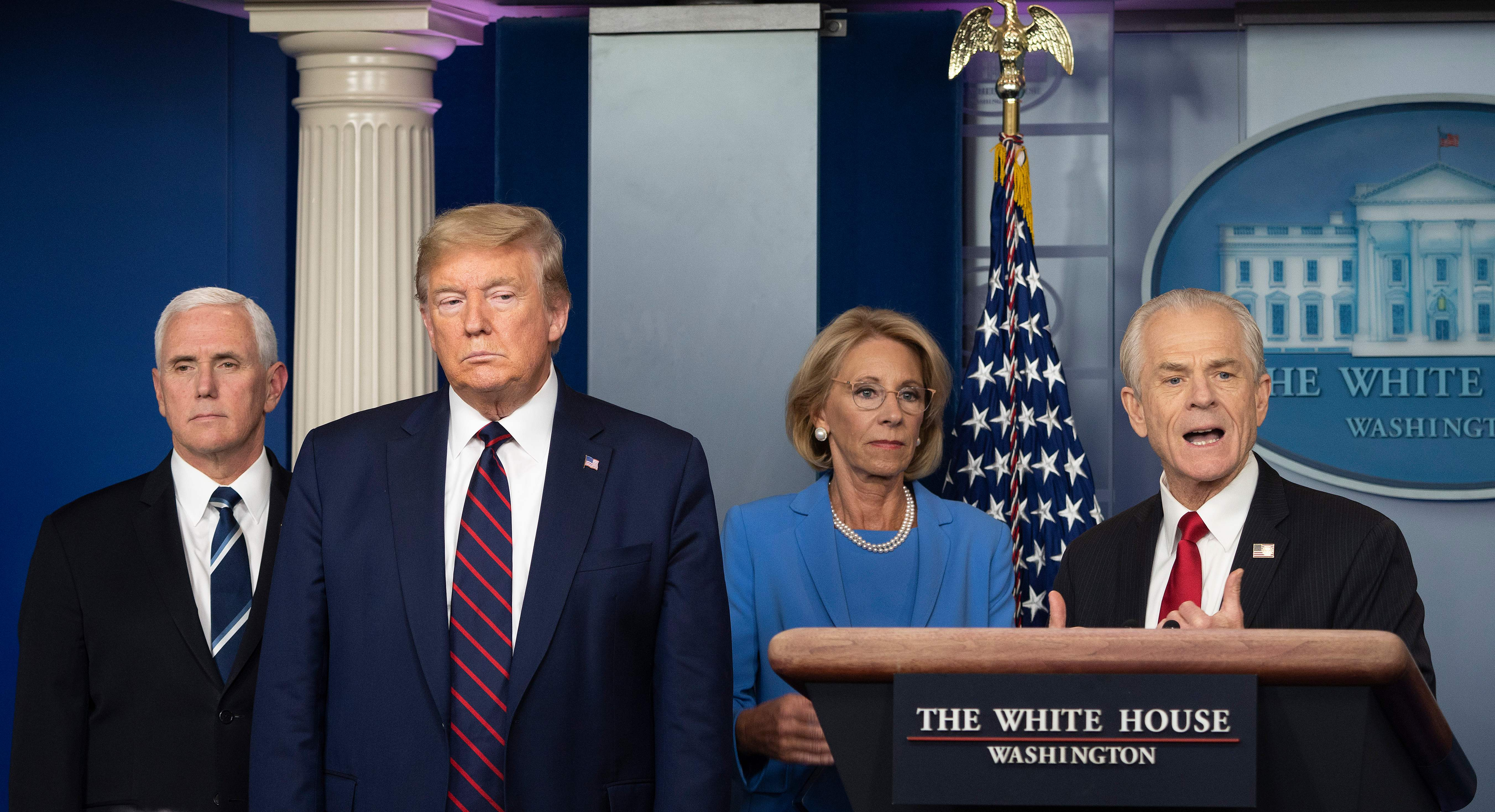 White House Trade and Manufacturing Policy adviser Peter Navarro (R) speaks alongside US President Donald Trump, Vice President Mike Pence (L) and Education Secretary Betsy DeVos (2nd R) during the daily briefing on the novel coronavirus, COVID-19, in the Brady Briefing Room at the White House on March 27, 2020, in Washington, DC. (Photo by JIM WATSON/AFP via Getty Images)