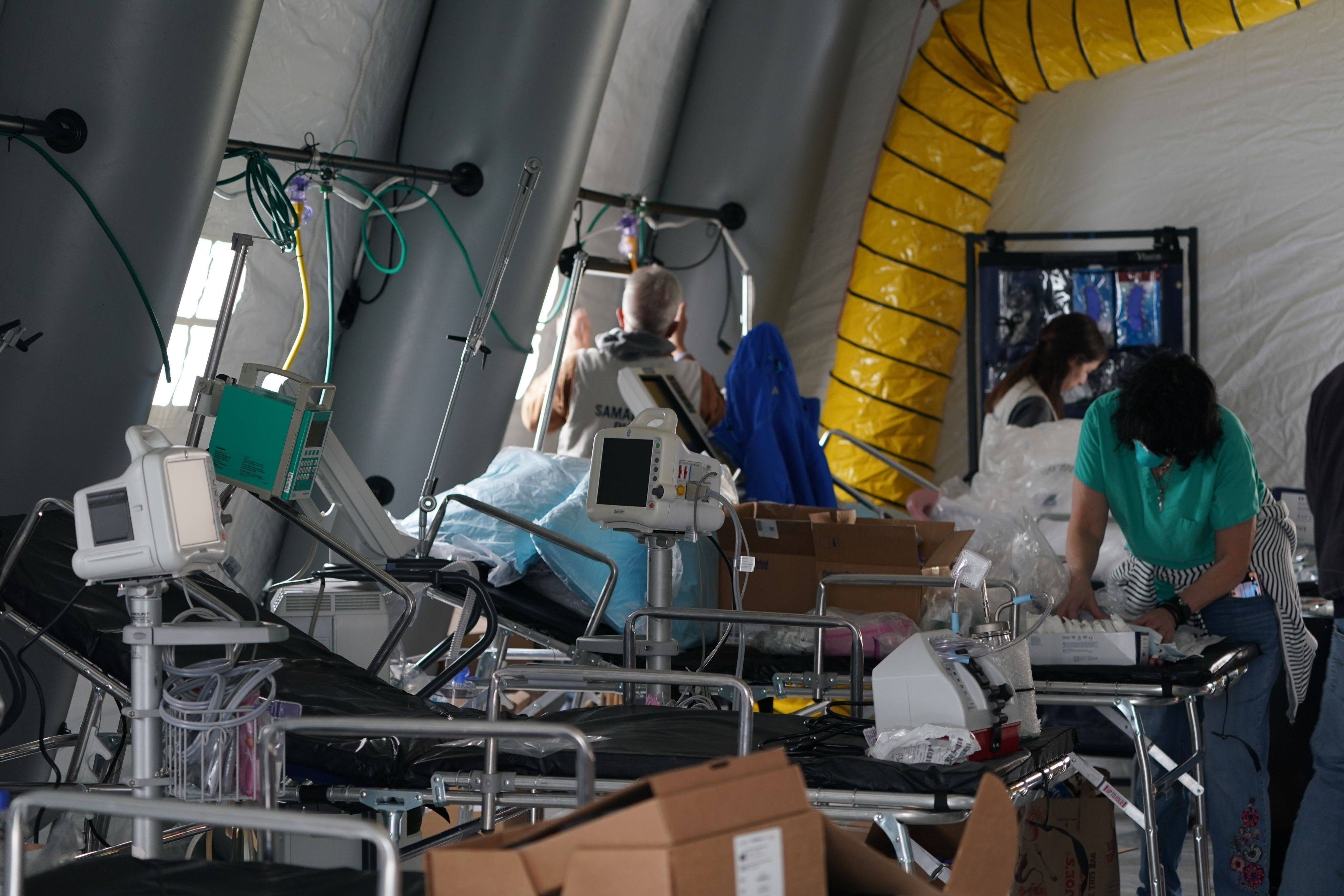 Medical supplies and beds are seen inside a tent as volunteers from the International Christian relief organization Samaritans Purse. (Photo by BRYAN R. SMITH/AFP via Getty Images)