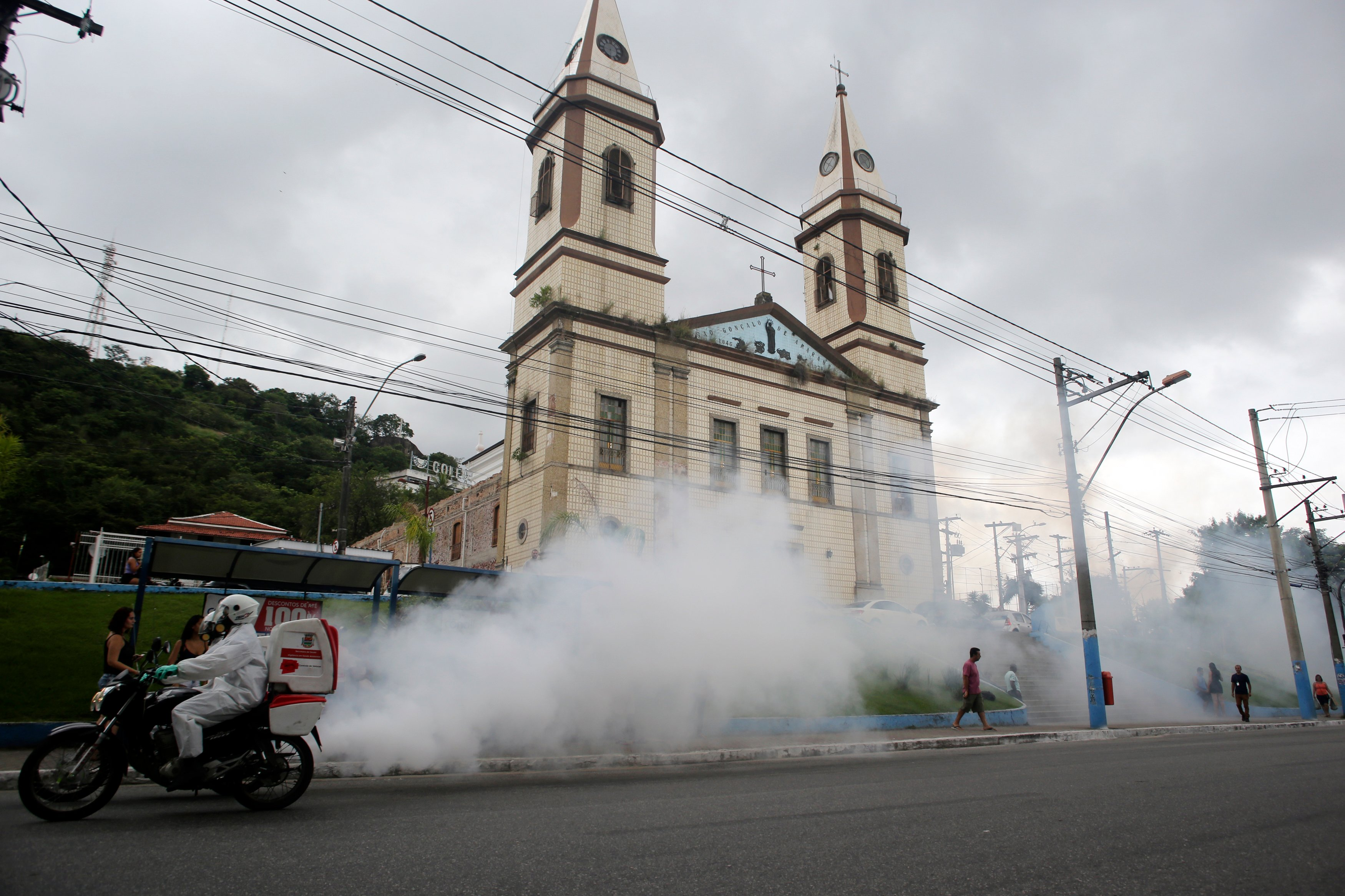 Endemic control agents disinfecting the city on 'motofogs' (A motorcycle equipped with a fumigation system) on March 31, 2020 in Sao Goncalo, Brazil. (Photo by Luis Alvarenga/Getty Images)