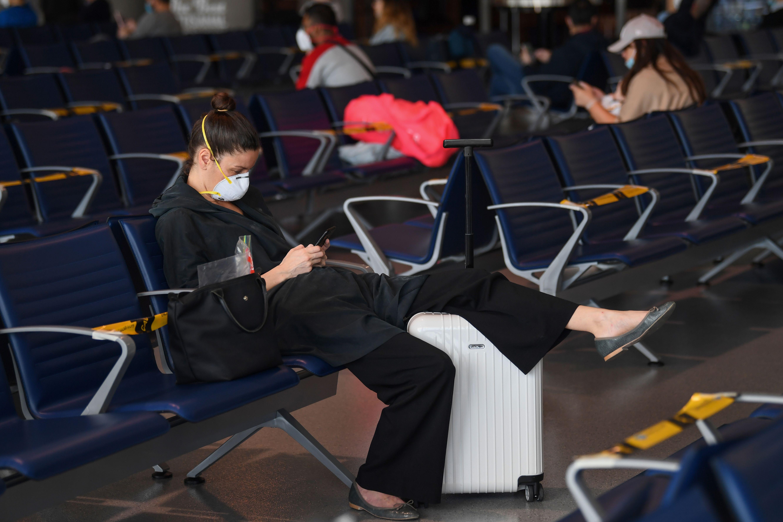 Passengers bound for Frankfurt wait at a terminal of Dubai International Airport on April 6, 2020.(Photo by KARIM SAHIB/AFP via Getty Images)