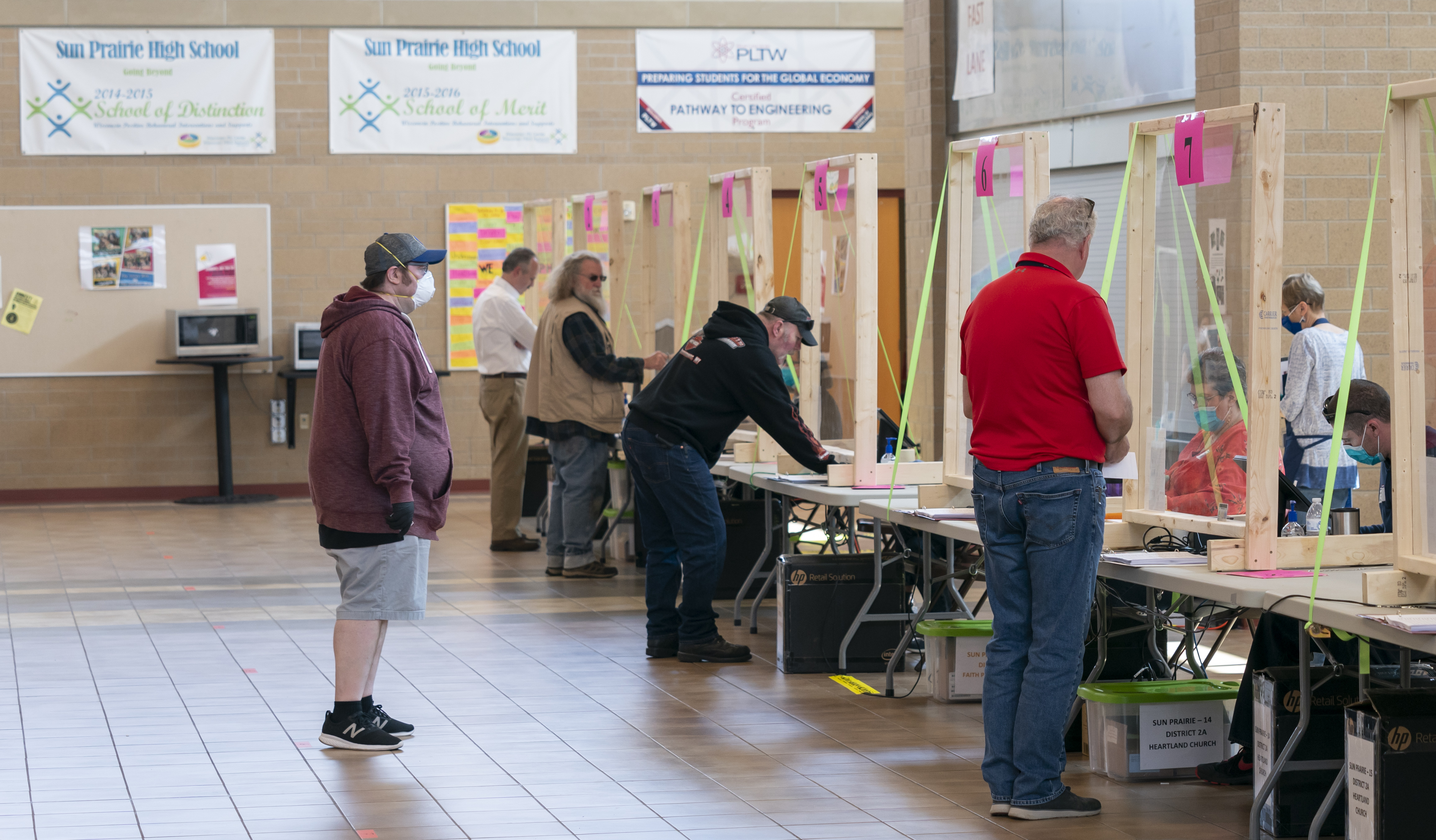 SUN PRAIRIE, WI - APRIL 07: People check in to vote at a polling location on April 7, 2020 in Sun Prairie, Wisconsin. (Photo by Andy Manis/Getty Images)