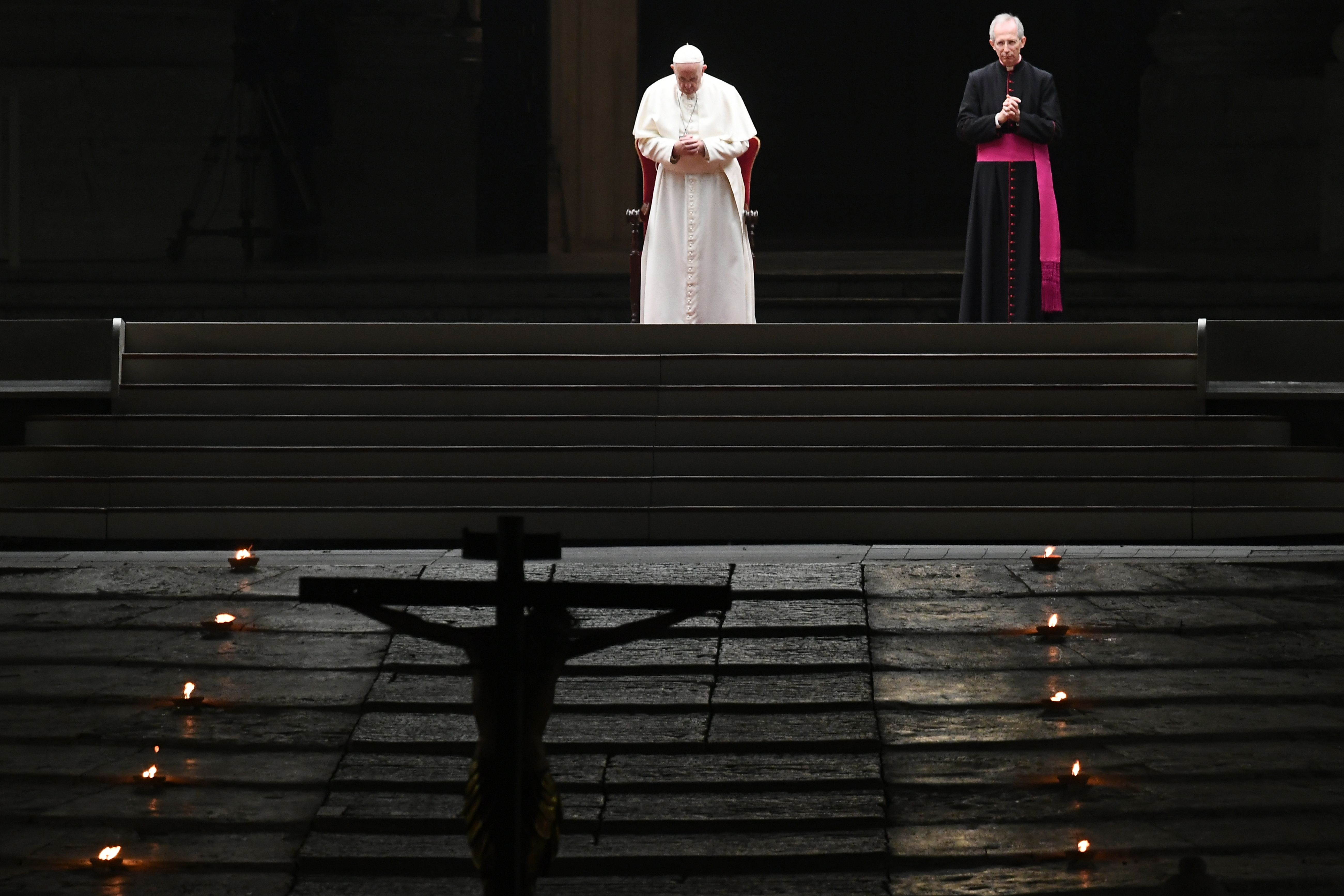 Pope Francis presides over Good Friday's Way of the Cross (Via Crucis) at St. Peter's Square in The Vatican on April 10, 2020. (Photo by VINCENZO PINTO/AFP via Getty Images)