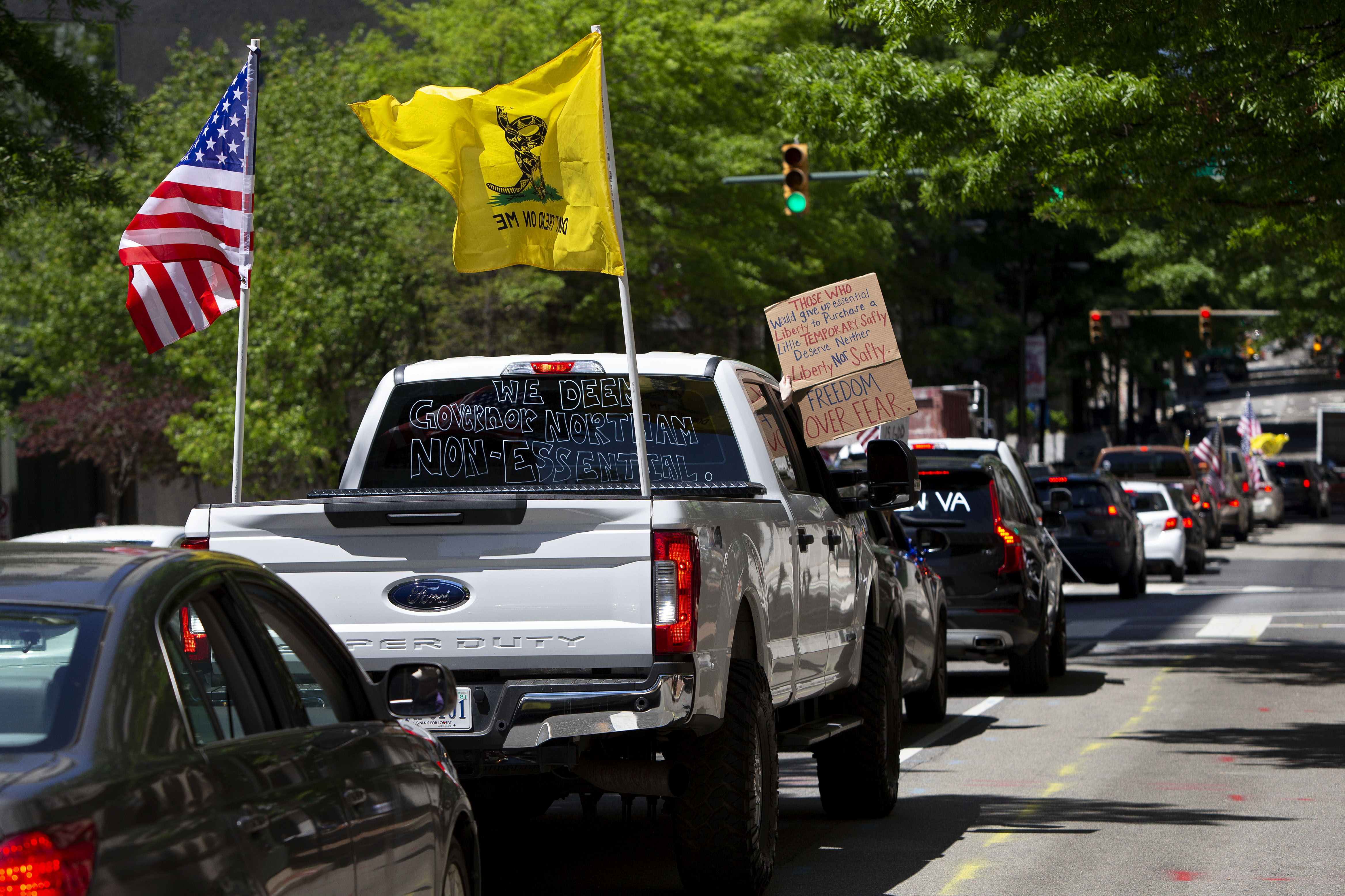 Drivers honk their horns during a reopen Virginia rally around Capitol Square in Richmond on April 22, 2020. (Photo by RYAN M. KELLY/AFP via Getty Images)