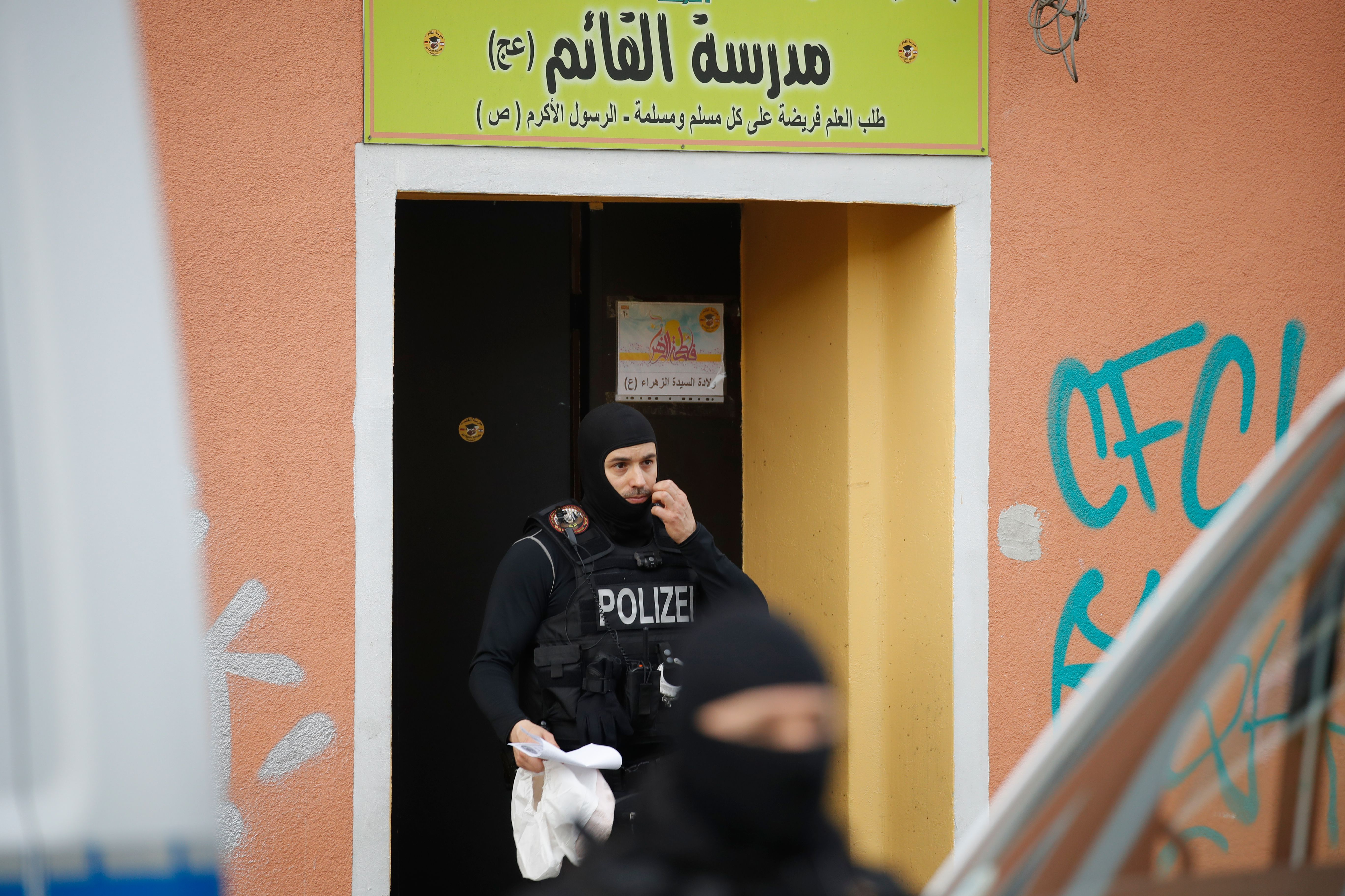 Police officers secure evidences at the Al-Irschad Mosque during a raid on April 30, 2020 in Berlin. (Photo by ODD ANDERSEN/AFP via Getty Images)