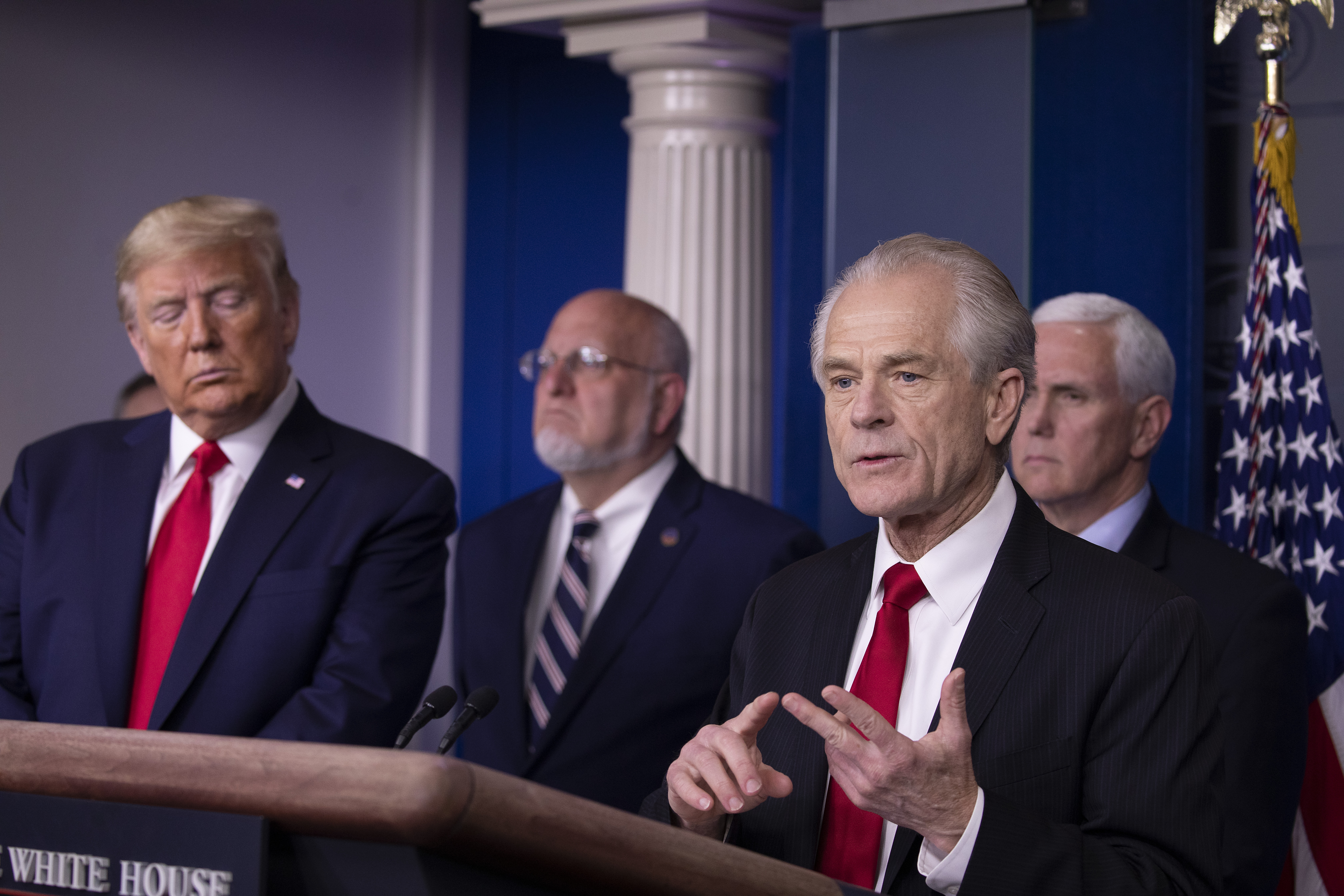 WASHINGTON, DC - MARCH 22: Peter Navarro, Director of the National Trade Council, speaks at the daily coronavirus briefing as President Donald Trump, Dr. Robert Redfield, Director of the Center for Disease Control and Prevention and Vice President Mike Pence listen in the James Brady Press Briefing Room at the White House on March 22, 2020 in Washington, DC. During the briefing President Trump announced thatthe National Guard will be deployed to New York, Washington State and California. Congress continues to work on legislation this weekend for a trillion dollar aid package to fight the coronavirus (COVID-19) pandemic. (Photo by Tasos Katopodis/Getty Images)