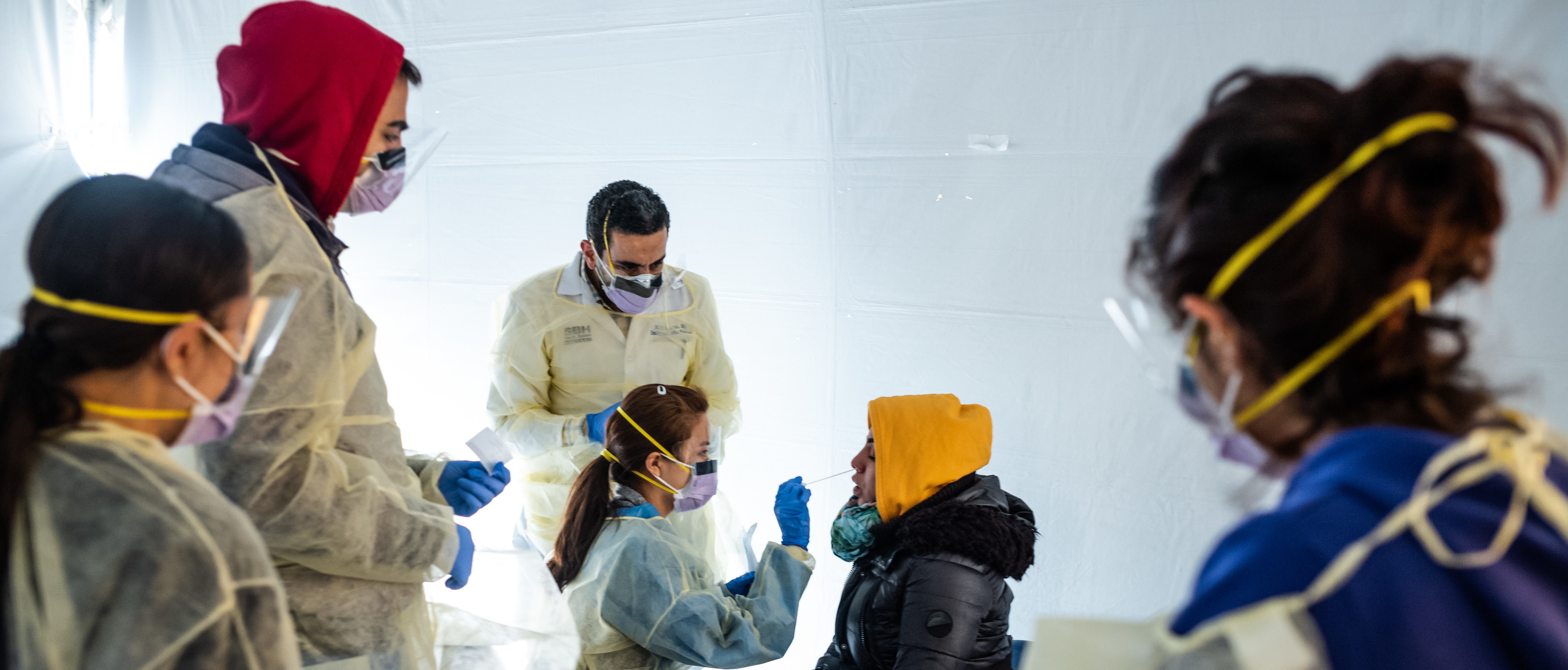 Doctors test hospital staff with flu-like symptoms for coronavirus (COVID-19) in set-up tents to triage possible COVID-19 patients. (Photo by Misha Friedman/Getty Images)