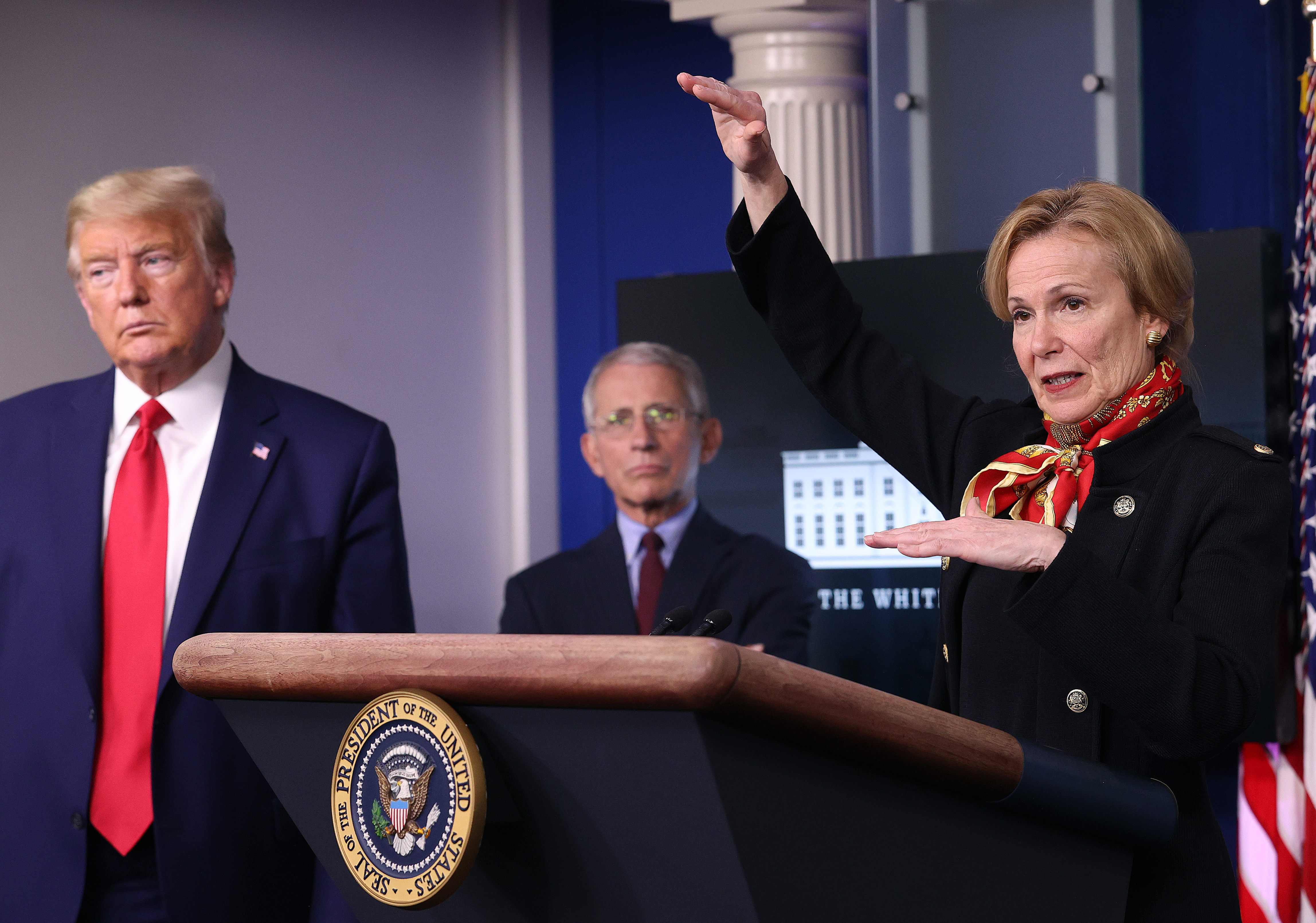 WASHINGTON, DC - MARCH 31: White House coronavirus response coordinator Debbie Birx speaks while flanked by President Donald Trump (L), and Dr. Anthony Fauci (C), director of the National Institute of Allergy and Infectious Diseases, during the daily coronavirus task force briefing in the Brady Briefing room at the White House on March 31, 2020 in Washington, DC. With the nationwide death toll rising due to the coronavirus, the United States has extended its social distancing practices through the end of April, while many states have issued stay-at-home orders that strongly discourage residents from leaving home unless absolutely necessary or essential. (Photo by Win McNamee/Getty Images)
