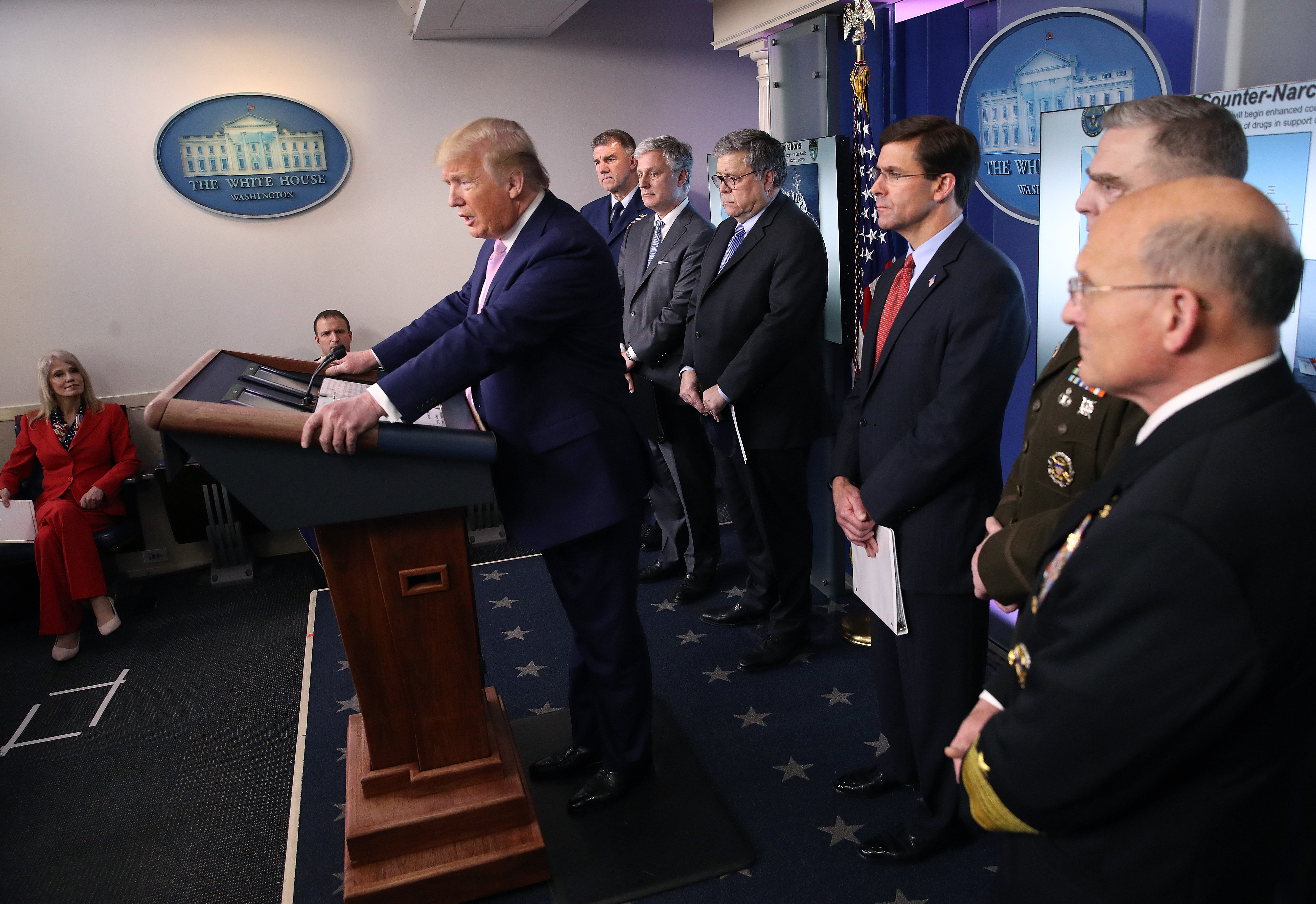 WASHINGTON, DC - APRIL 01: U.S. President Donald Trump speaks at the press briefing room flanked by (L-R) U.S. Coast Guard Commandant Admiral Karl Schultz, National Security Advisor Robert O'Brien, Attorney General William Barr, Defense Secretary Mark Esper, Chairman of the Joint Chiefs of Staff Gen. Mark Milley and Chief of Naval Operations Admiral Michael Gilday on April 1, 2020 in Washington, DC. After announcing yesterday that COVID-19 could kill between 100,000 and 240,000 Americans, the Trump administration is also contending with the economic effects of the outbreak as the stock market continues to fall, businesses remain closed, and companies lay off and furlough employees. (Photo by Win McNamee/Getty Images)