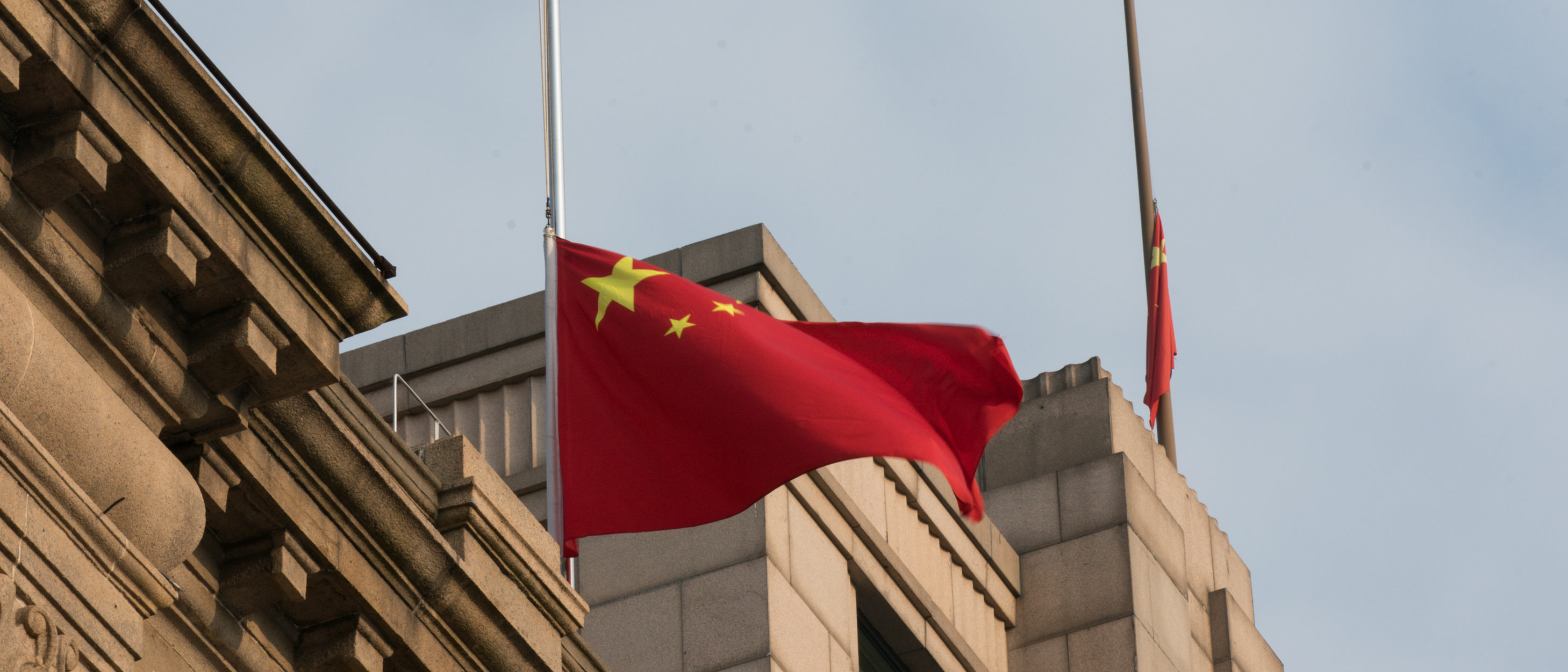 The Chinese national flag flies at half-mast at the Bund to mourn victims of COVID-19 on April 04, 2020 in Shanghai, China. (Yifan Ding/Getty Images)