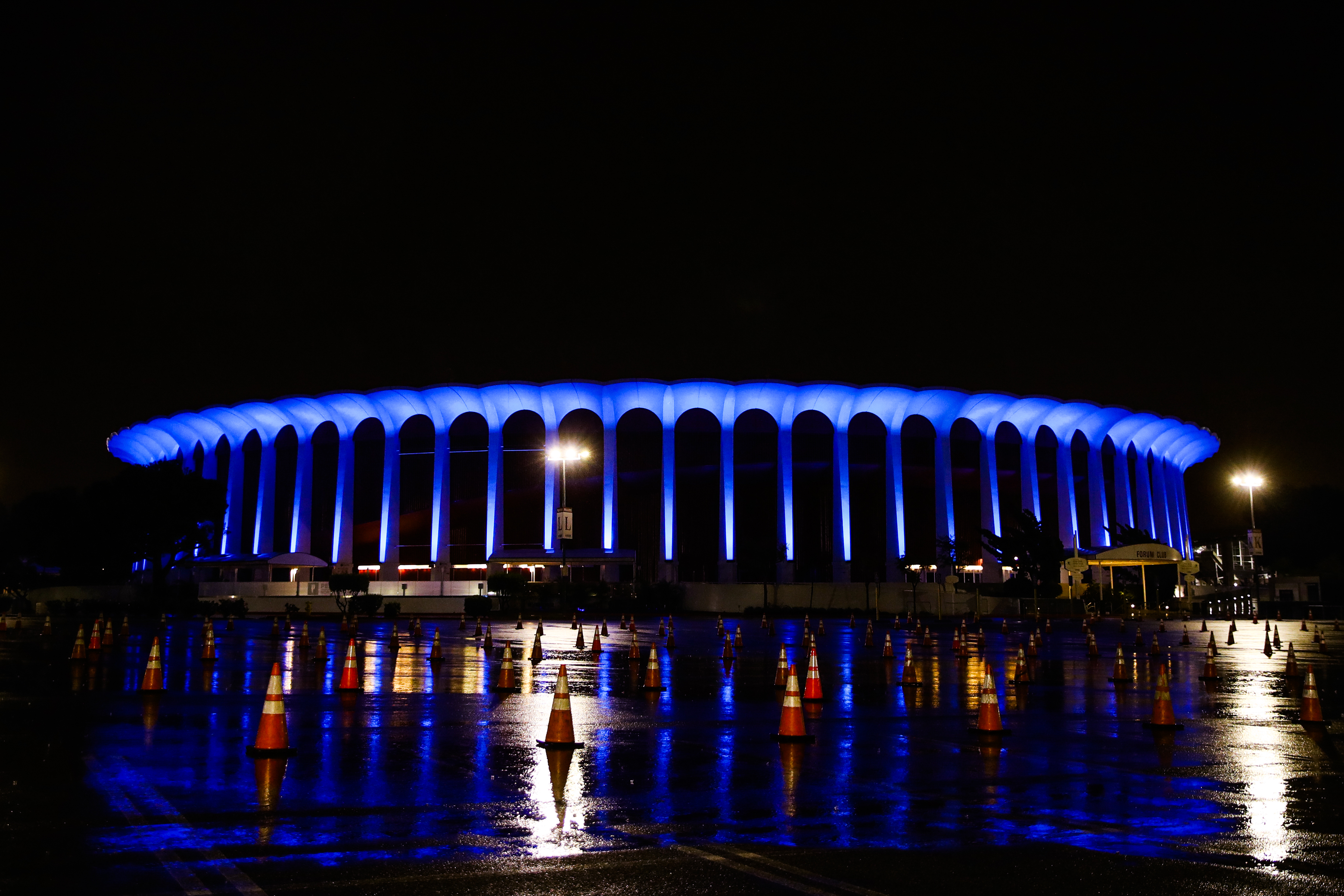 INGLEWOOD, CALIFORNIA - APRIL 09: The Forum is illuminated in blue lights as part of the #LightItBlue for Health Workers movement on April 09, 2020 in Inglewood, United States. Landmarks and buildings across the nation are displaying blue lights to show support for health care workers and first responders on the front lines of the COVID-19 pandemic. (Photo by Rich Fury/Getty Images)
