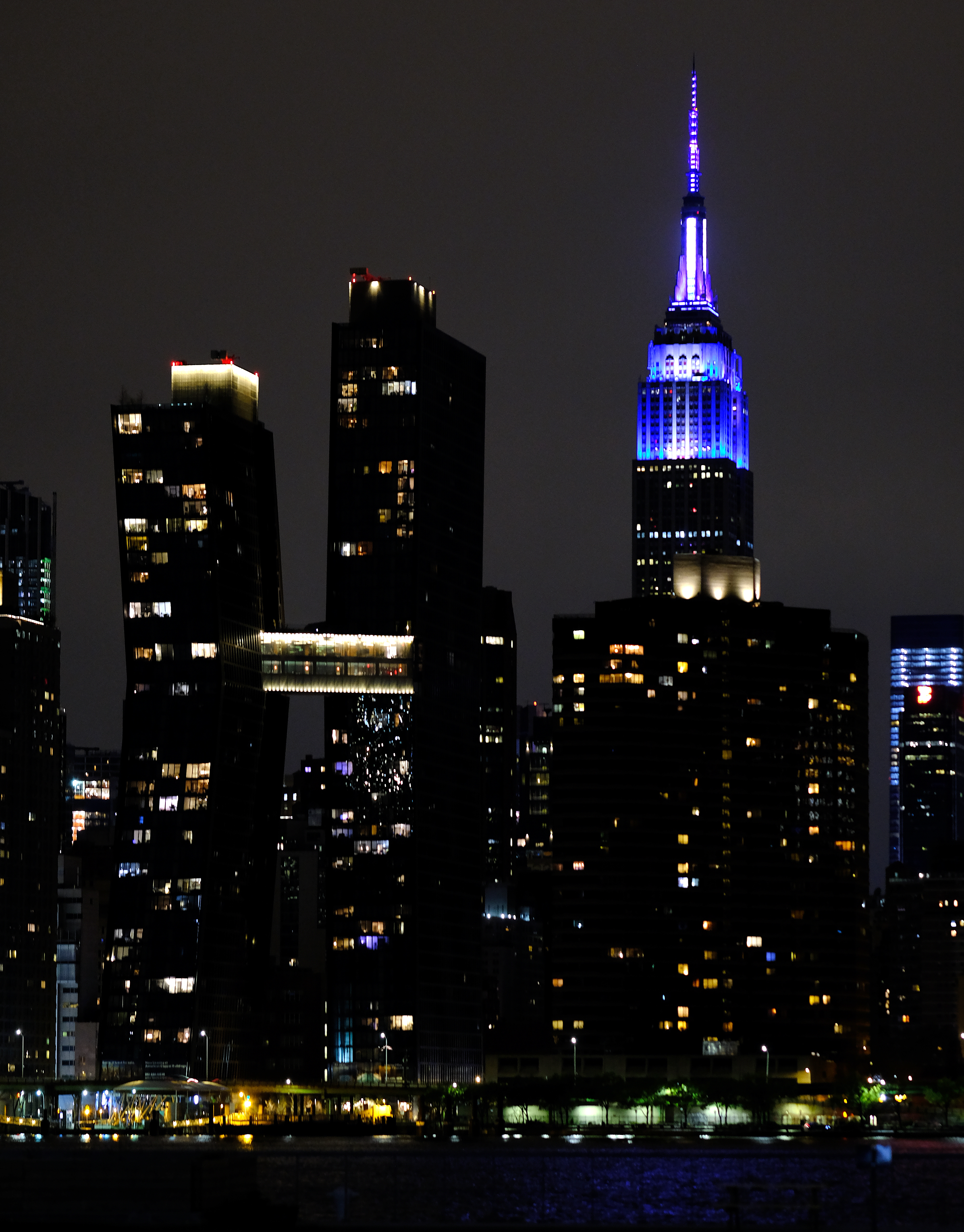 NEW YORK, NEW YORK - APRIL 09: The Empire State Building is illuminated in blue as part of the #LightItBlue for Health Workers movement on April 09, 2020 in New York City. Landmarks and buildings across the nation are displaying blue lights to show support for health care workers and first responders on the front lines of the COVID-19 pandemic. (Photo by Dimitrios Kambouris/Getty Images)