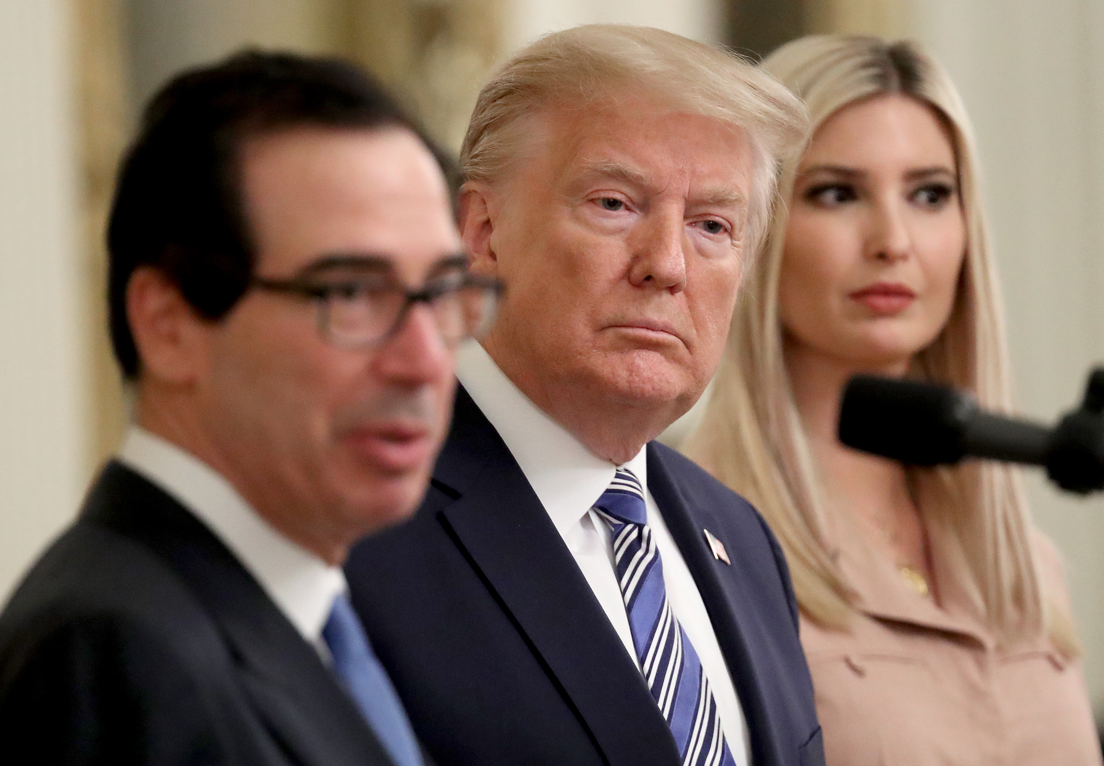 WASHINGTON, DC - APRIL 28: U.S. President Donald Trump and his daughter Ivanka listen as U.S .Treasury Secretary Steven Mnuchin speaks during an event on supporting small businesses through the Paycheck Protection Program in the East Room of the White House April 28, 2020 in Washington, DC. An total of $659 billion has been allocated for small business loans in coronavirus relief bills passed by Congress. (Photo by Win McNamee/Getty Images)