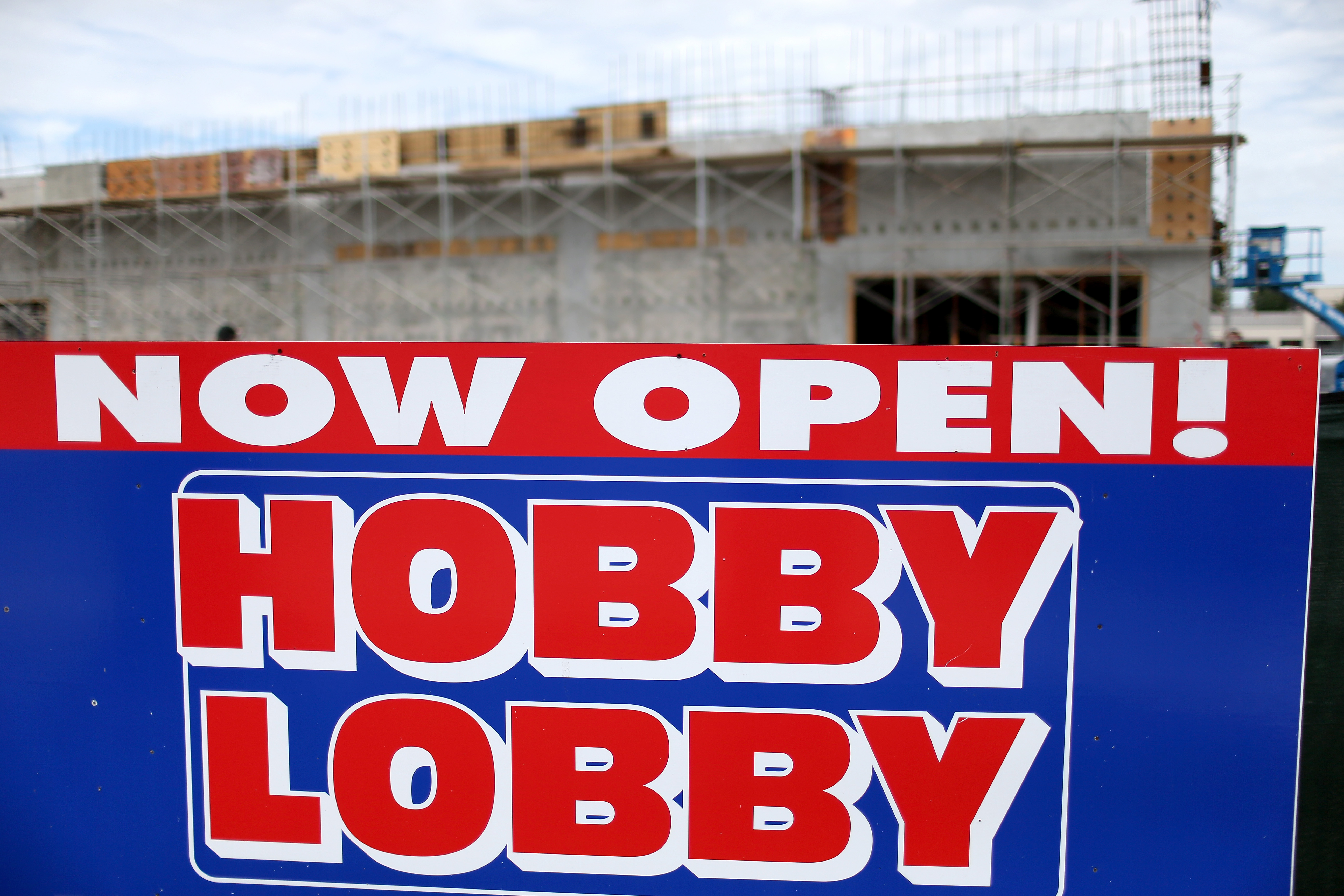A sign stands near a newly opened Hobby Lobby store on June 30, 2014 in Plantation, Florida. (Photo by Joe Raedle/Getty Images)