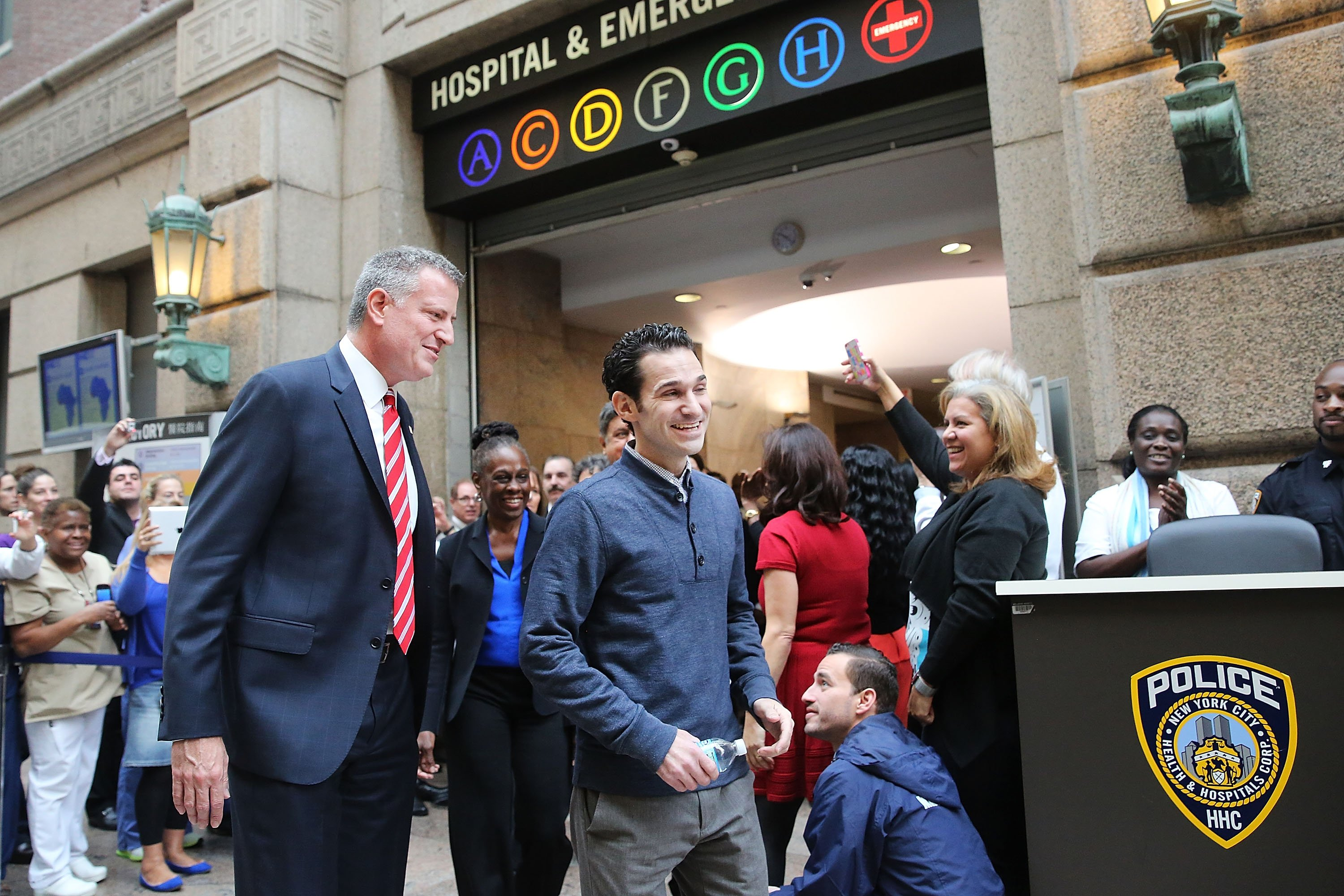Dr. Craig Spencer walks with Bill de Blasio at a news conference at New York's Bellevue Hospital after being declared free of Ebola on November 11, 2014 in New York City. (Photo by Spencer Platt/Getty Images)