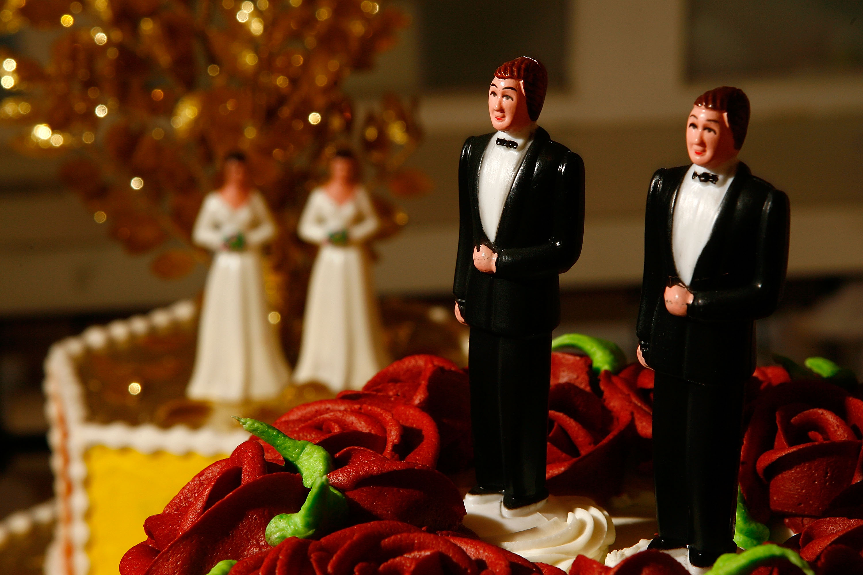 Same-sex wedding cake topper figurines are seen at Cake and Art cake decorators. (Photo by David McNew/Getty Images)