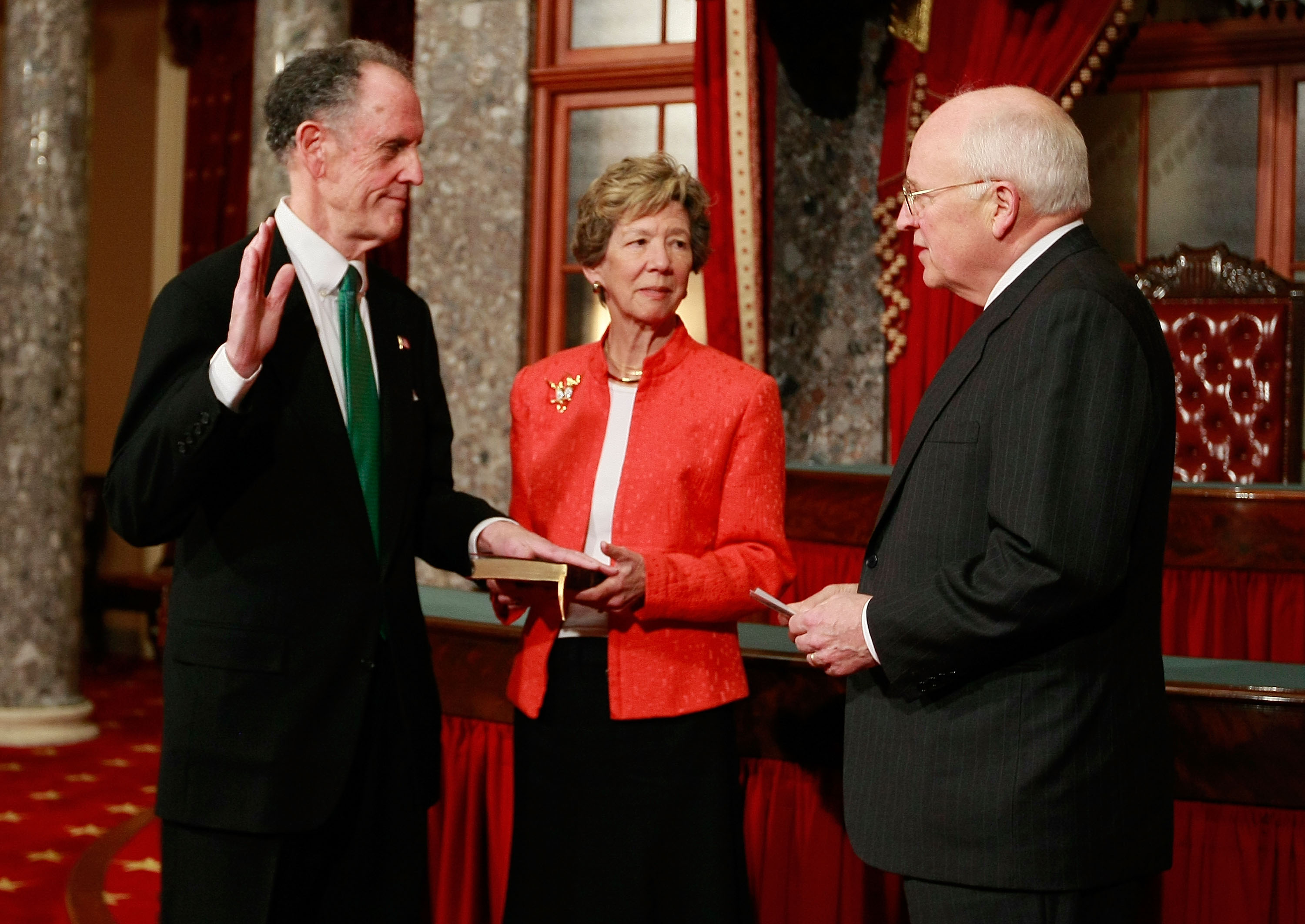 WASHINGTON - JANUARY 16: Appointed Sen. Ted Kaufman (D-DE) (L) raises his right hand and is sworn in by Vice President Dick Cheney (R) as his wife Lynne Kaufman (C) holds the bible in the Old Senate Chamber at the U.S. Capitol on January 16, 2009 in Washington, DC. Governor Ruth Ann Minner of Delaware appointed Kaufman to take the seat as a junior Senator left vacant by Vice President-Elect Jospeh Biden. (Photo by Mark Wilson/Getty Images)