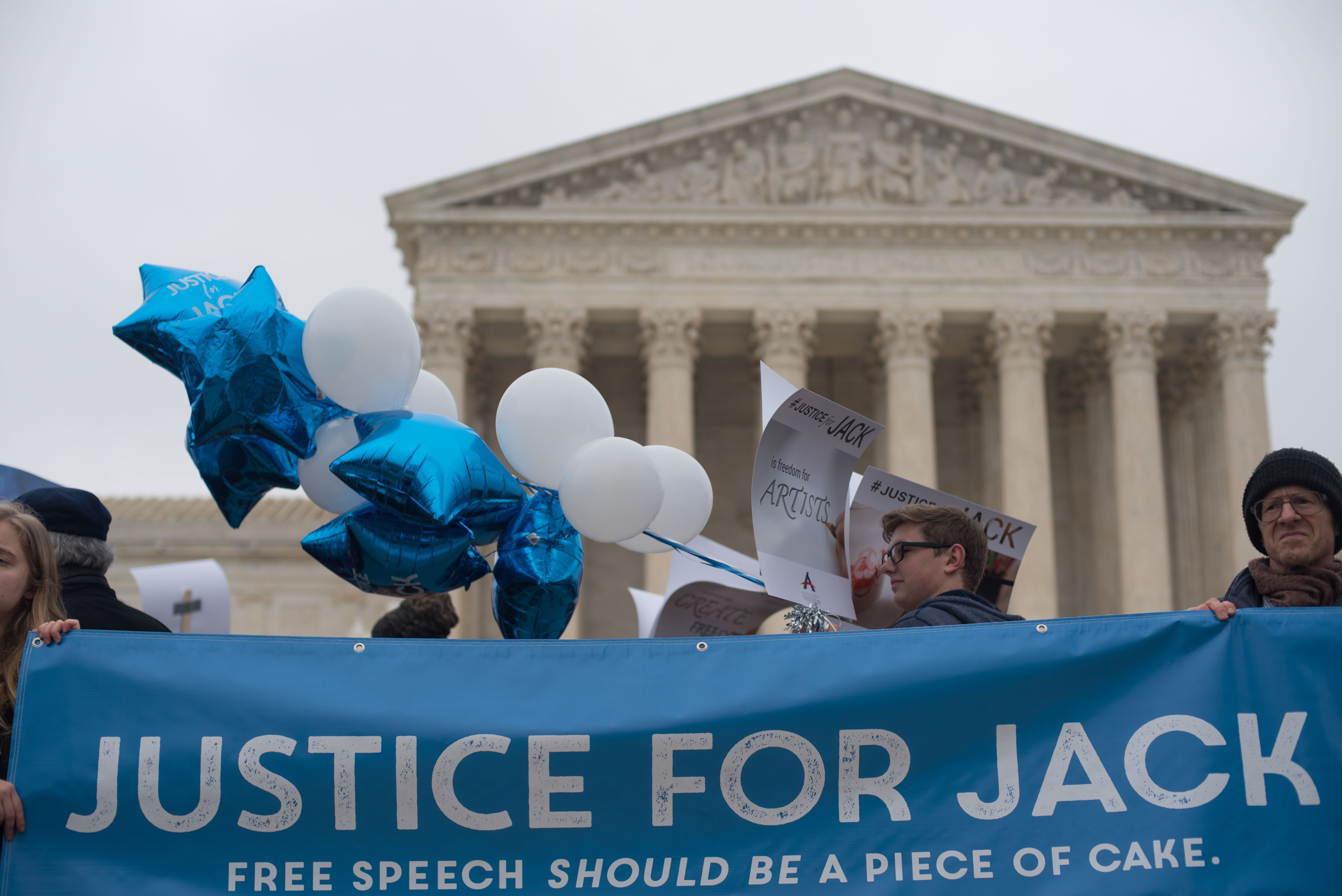 People rally for Jack Phillips, owner of Masterpiece Cake in Colorado, outside the US Supreme Court before Masterpiece Cakeshop vs. Colorado Civil Rights Commission is heard on December 5, 2017 in Washington, DC. (MARI MATSURI/AFP via Getty Images)