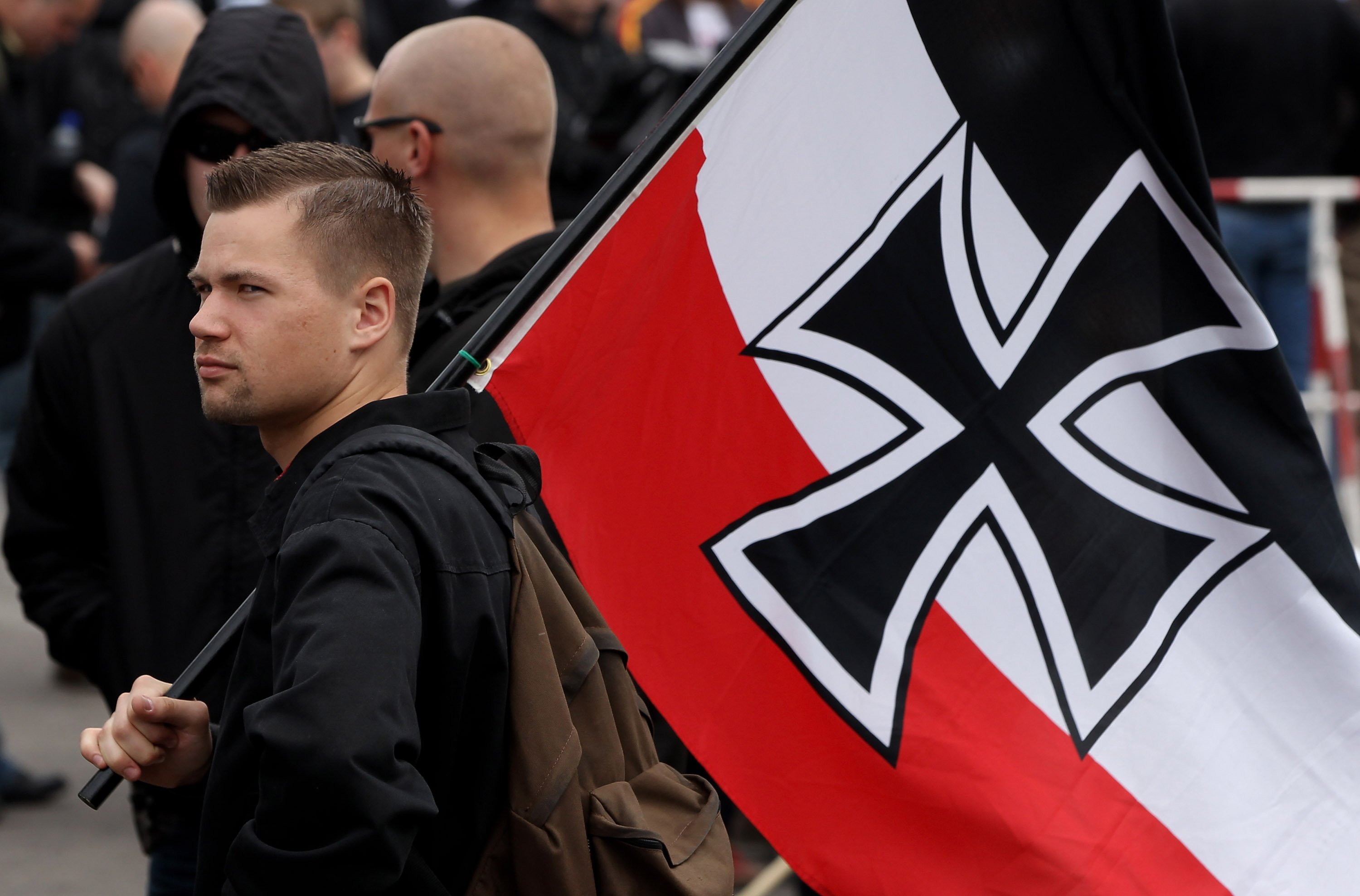 A neo-Nazi supporter arrives bearing colours of the pre-World War I German Empire. (Photo by Sean Gallup/Getty Images)