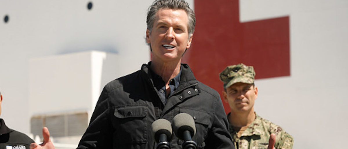 LOS ANGELES, CA - MARCH 27: California Governor Gavin Newsom speaks in front of the hospital ship USNS Mercy that arrived into the Port of Los Angeles on Friday, March 27, 2020, to provide relief for Southland hospitals overwhelmed by the coronavirus pandemic. Also attending the press conference were Director Mark Ghilarducci, Cal OES, left, Admiral John Gumbleton, United States Navy, right, and many others not shown including Mayor Eric Garcetti and Dr. Mark Ghaly, Secretary of Health and Human Services. (Photo by Carolyn Cole-Pool/Getty Images)