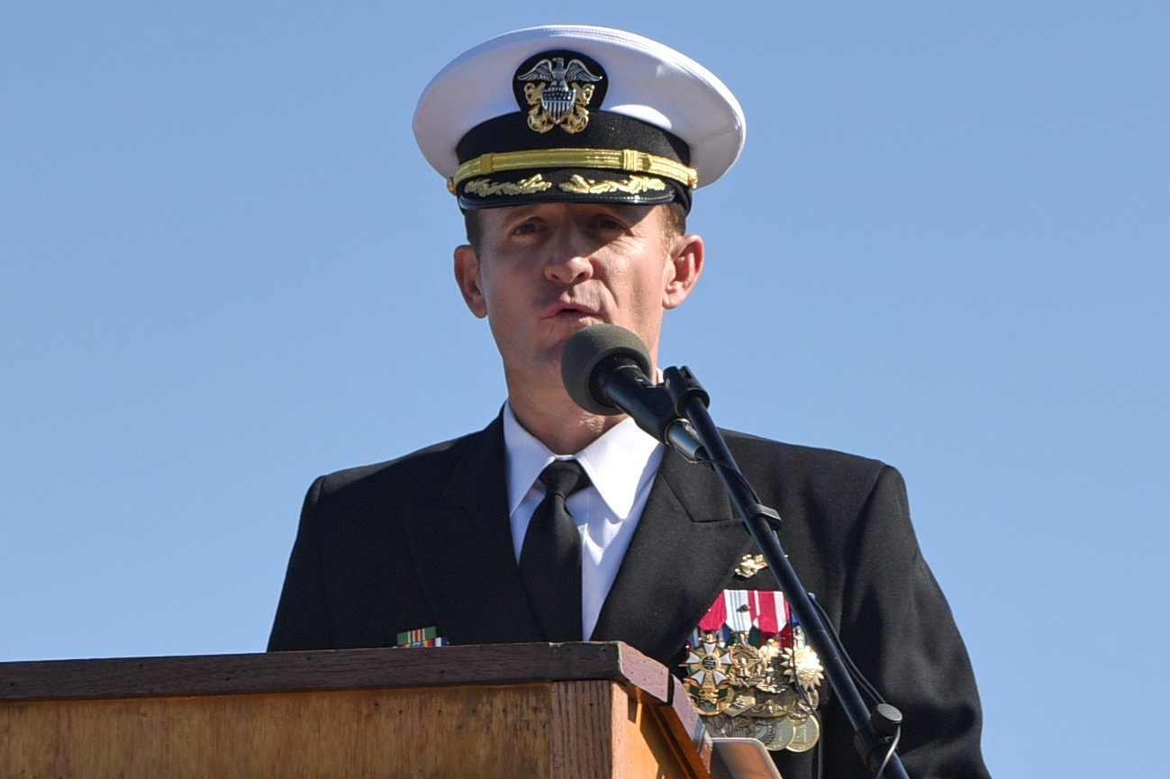 REFILE - CORRECTING YEAR Captain Brett Crozier addresses the crew for the first time as commanding officer of the aircraft carrier USS Theodore Roosevelt during a change of command ceremony on the ship's flight deck in San Diego, California, U.S. November 1, 2019. Picture taken November 1, 2019. U.S. Navy/Mass Communication Specialist 3rd Class Sean Lynch/Handout via REUTERS. THIS IMAGE HAS BEEN SUPPLIED BY A THIRD PARTY. THIS IMAGE WAS PROCESSED BY REUTERS TO ENHANCE QUALITY, AN UNPROCESSED VERSION HAS BEEN PROVIDED SEPARATELY. - RC2NWF9BSXUC