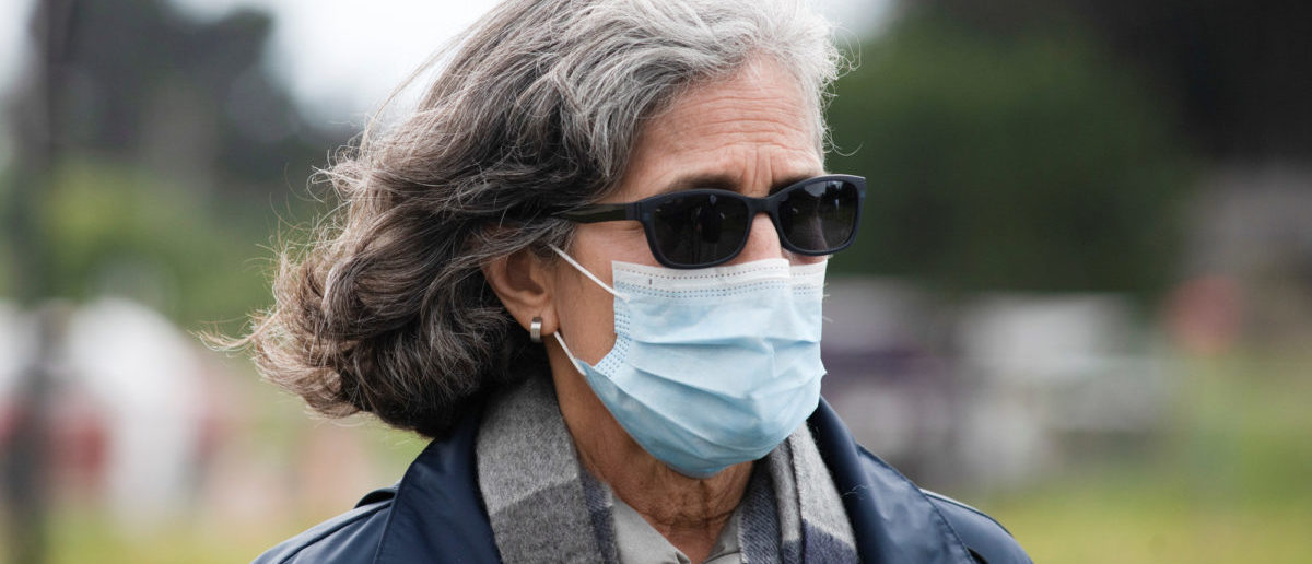 Dr. Aenor Sawyer, a physician at UCSF and resident of Bolinas, wears a face mask as she takes part in the testing of all village residents for the novel coronavirus and its antibodies on Monday, one of the first such efforts since the pandemic hit the United States three months ago to combat the coronavirus disease (COVID-19) crisis, in Bolinas, California, U.S. April 20, 2020. REUTERS/Kate Munsch