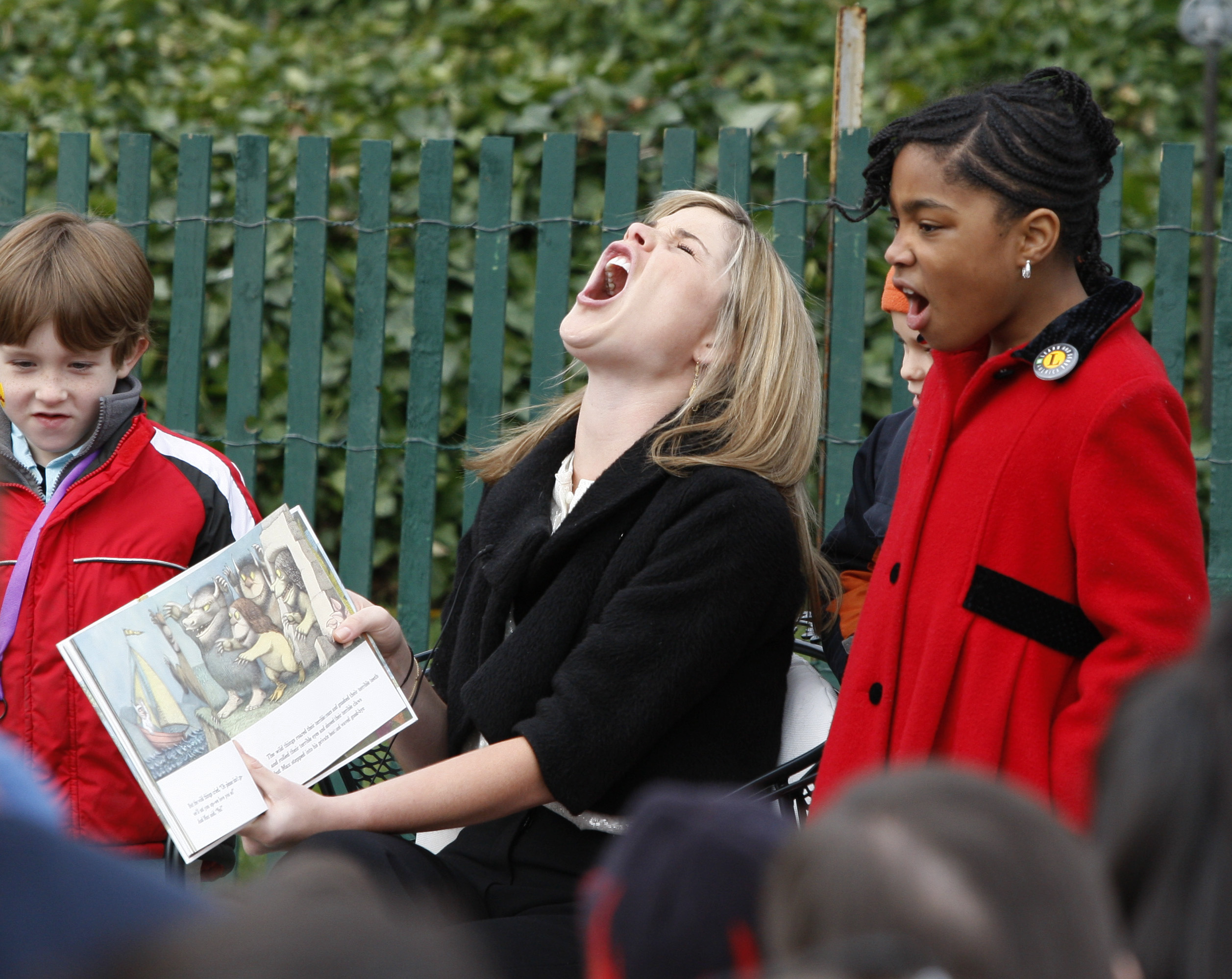 "Jenna Bush, the daughter of U.S. President George W. Bush, enacts one of the monster characters of the book ""Where the Wild Things Are"" during her book reading for children at the annual Easter Egg Roll on the South Lawn of the White House in Washington, March 24, 2008. The traditional White House event dates back to 1878. REUTERS/Jason Reed"