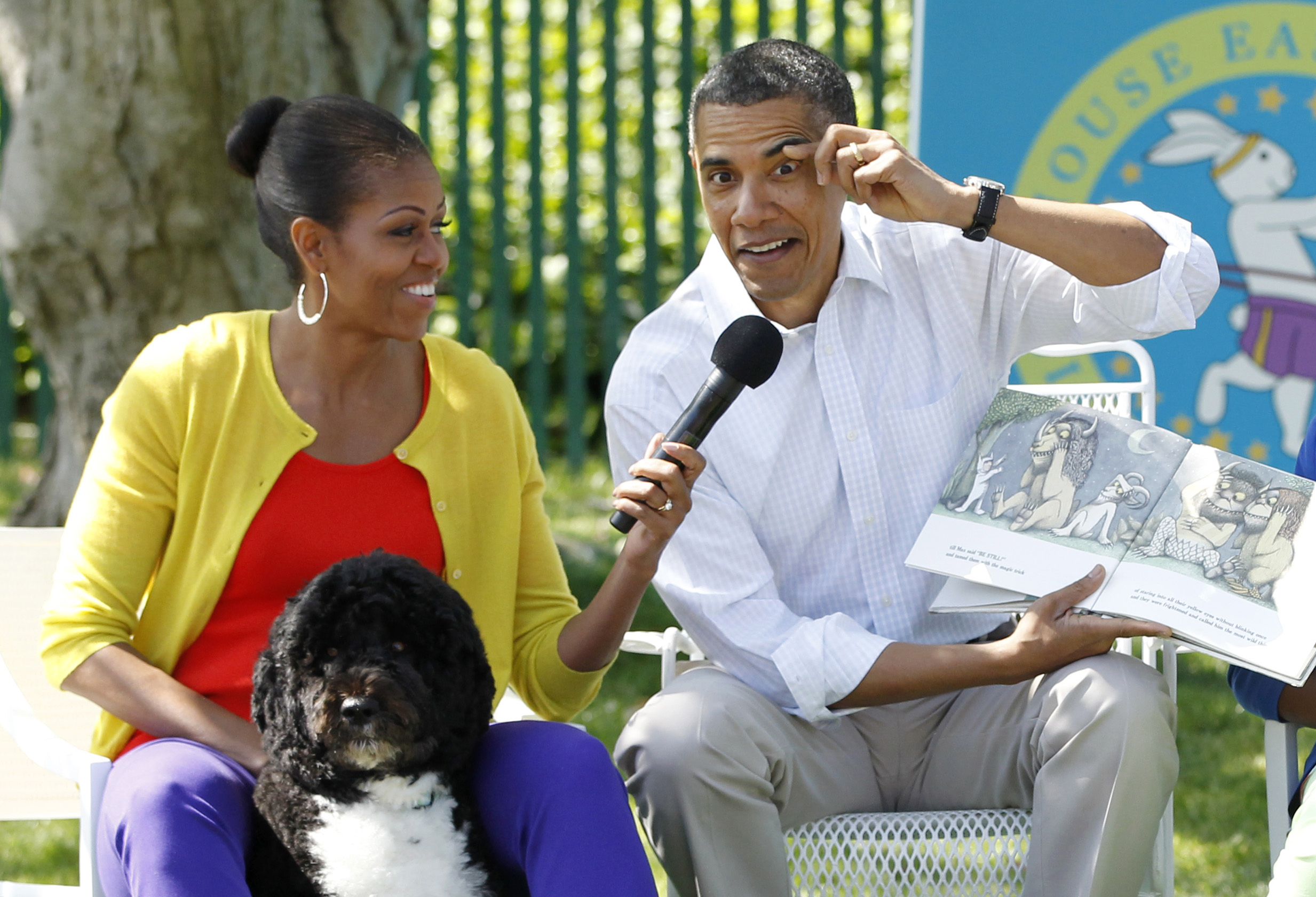 "U.S. President Barack Obama reads the children's book ""Where the Wild Things Are"" alongside first lady Michelle Obama during the annual White House Easter Egg Roll in Washington, April 9, 2012. REUTERS/Jason Reed"