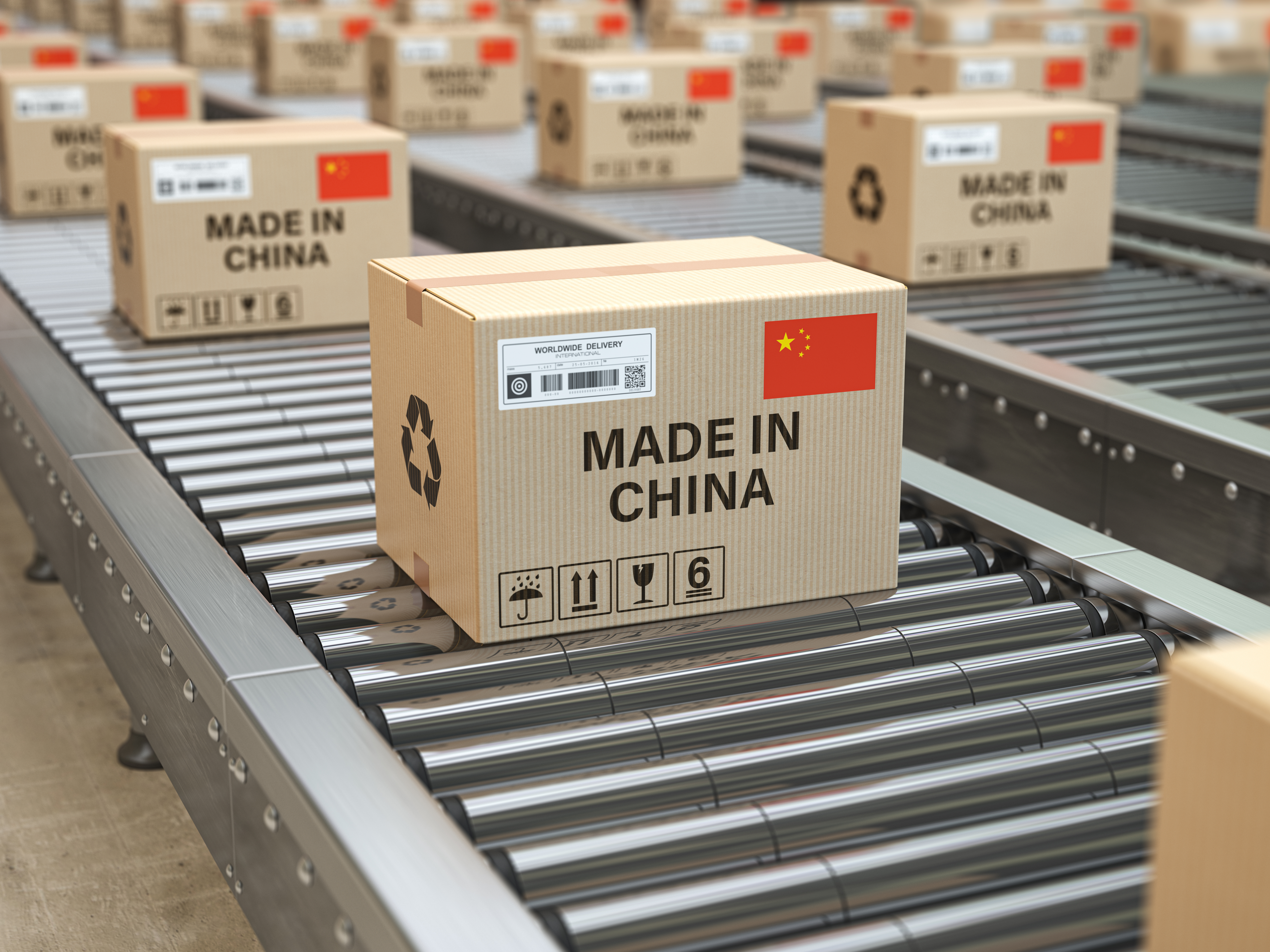 Made in China. Cardboard boxes with text made in China and chinese flag on the roller conveyor. 3d illustration (Shutterstock/Maxx-Studio)