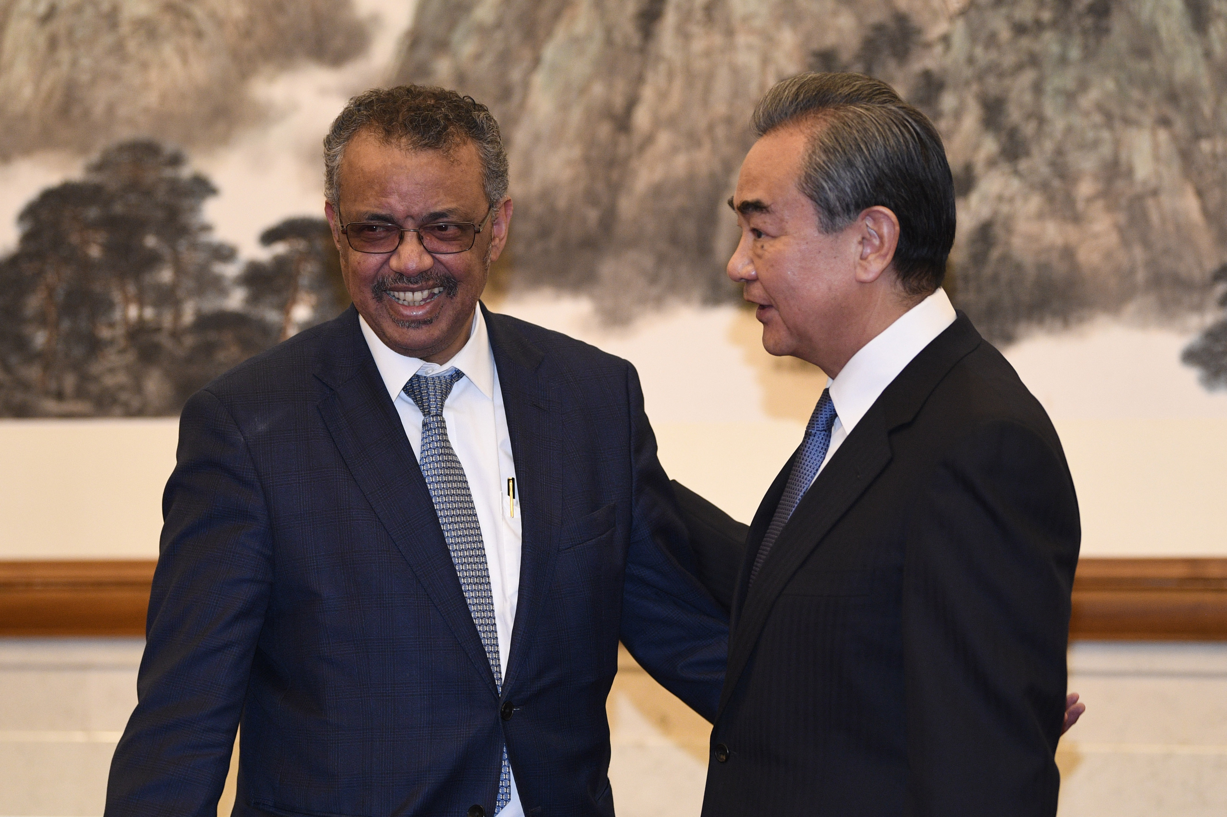 Photo: Tedros Adhanom, Director General of the World Health Organization, meets with with Chinese State Councilor and Foreign Minister Wang Yi at the Diaoyutai State Guesthouse on January 28, 2020 in Beijing, China. (Naohiko Hatta - Pool/Getty Images)