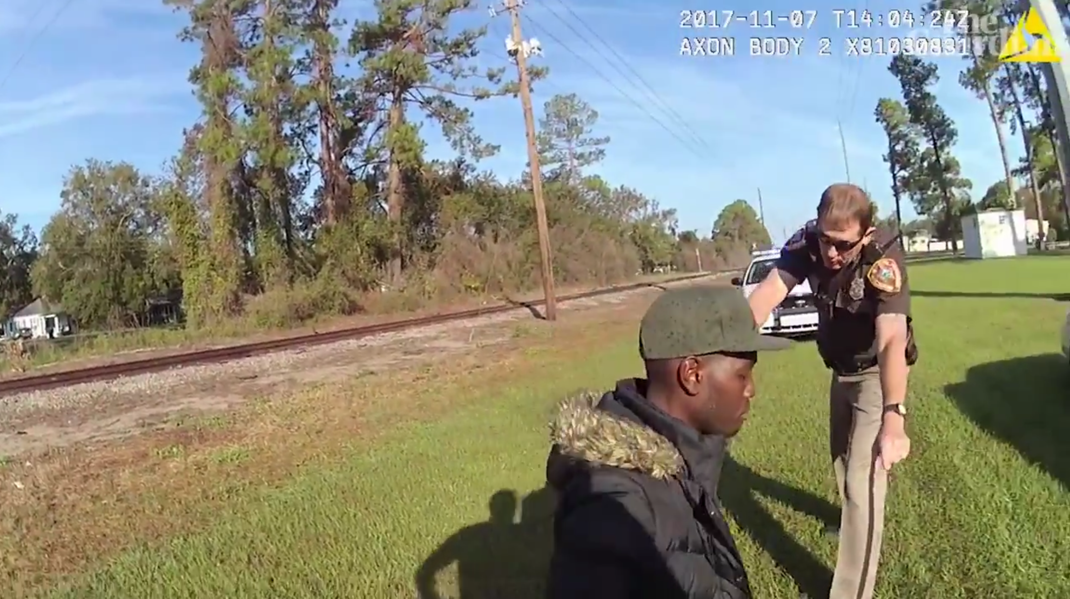 Police officer brandishing a taser while Ahmaud Arbery is on the ground. (Screenshot/The Guardian)