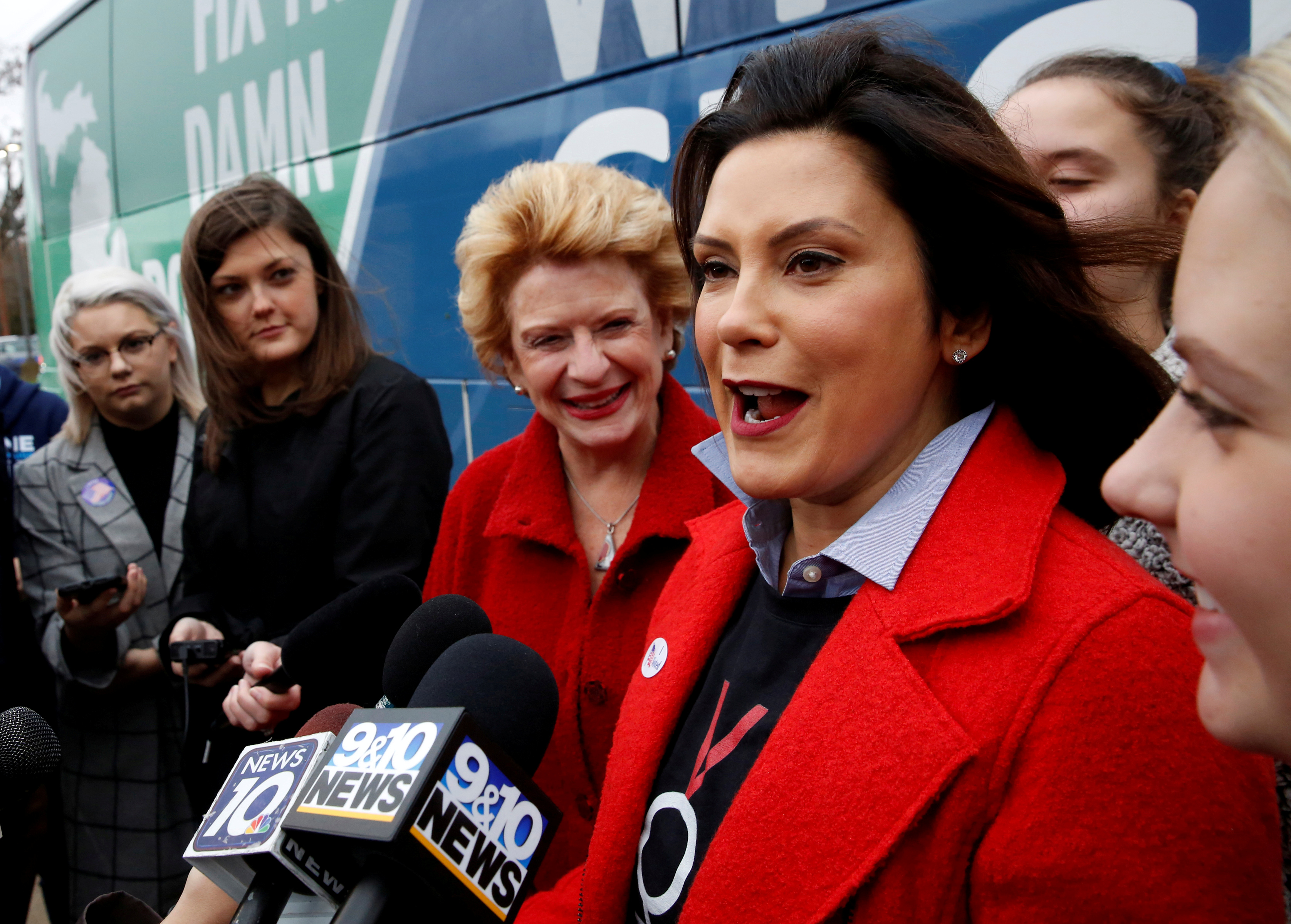 FILE PHOTO: Michigan Democratic gubernatorial candidate Gretchen Whitmer with U.S. Sen. Debbie Stabenow talk to reporters at polling station at the St. Paul Lutheran Church in East Lansing, Michigan, U.S. Nov. 6, 2018. REUTERS/Jeff Kowalsky/File Photo