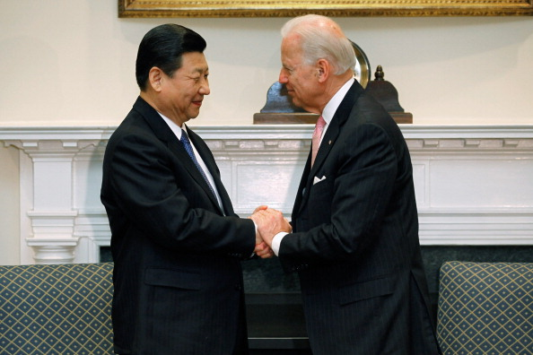 U.S. Vice President Joe Biden (R) and Chinese Vice President Xi Jinping shake hands in the Roosevelt Room at the White House February 14, 2012 in Washington, DC. (Photo by Chip Somodevilla/Getty Images)