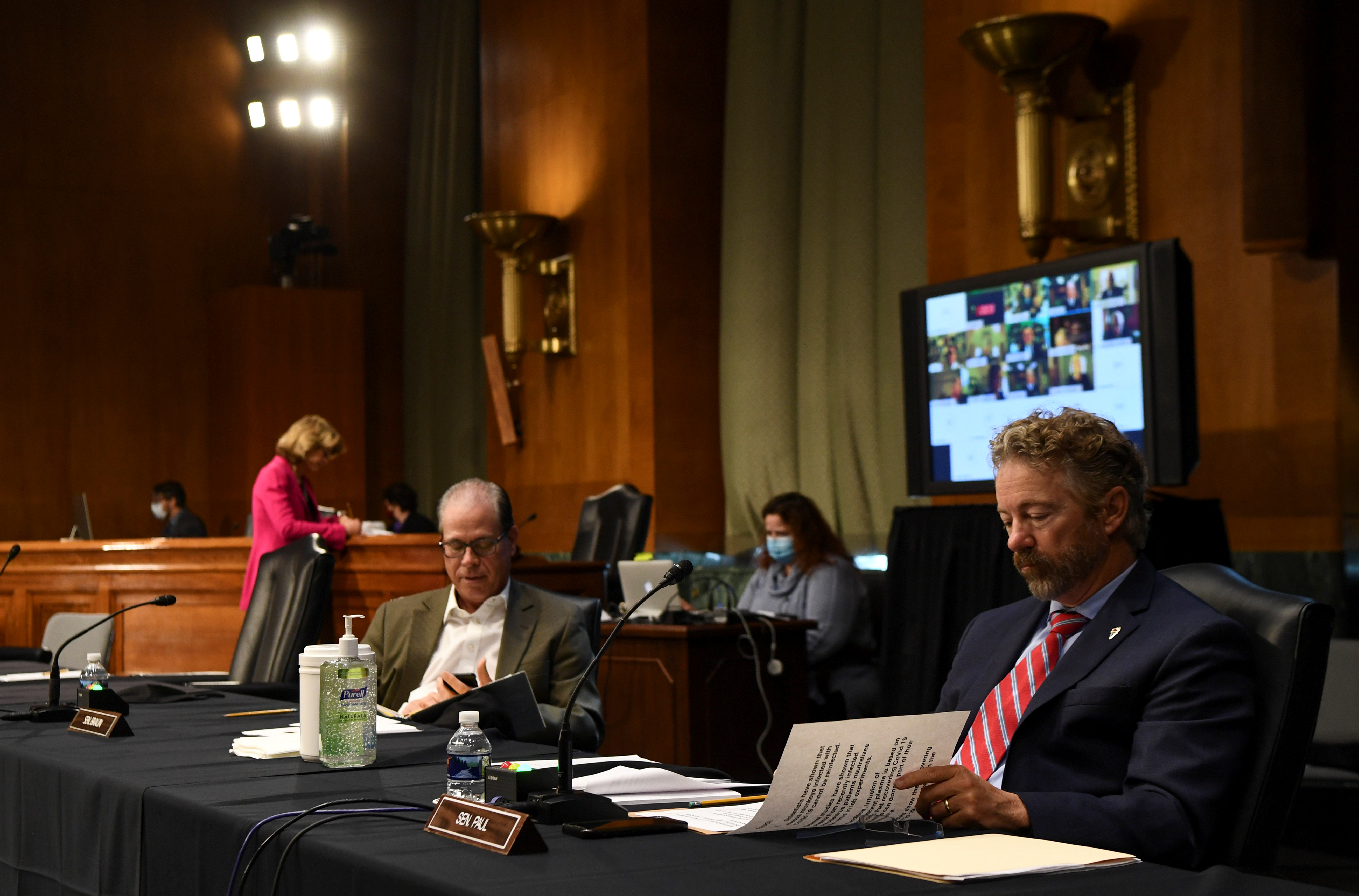 U.S. Senator Rand Paul (R-KY) looks over his notes during the Senate Committee for Health, Education, Labor, and Pensions hearing on the coronavirus disease (COVID-19) response, in Washington, U.S., May 12, 2020. Toni L. Sandys/Pool via REUTERS
