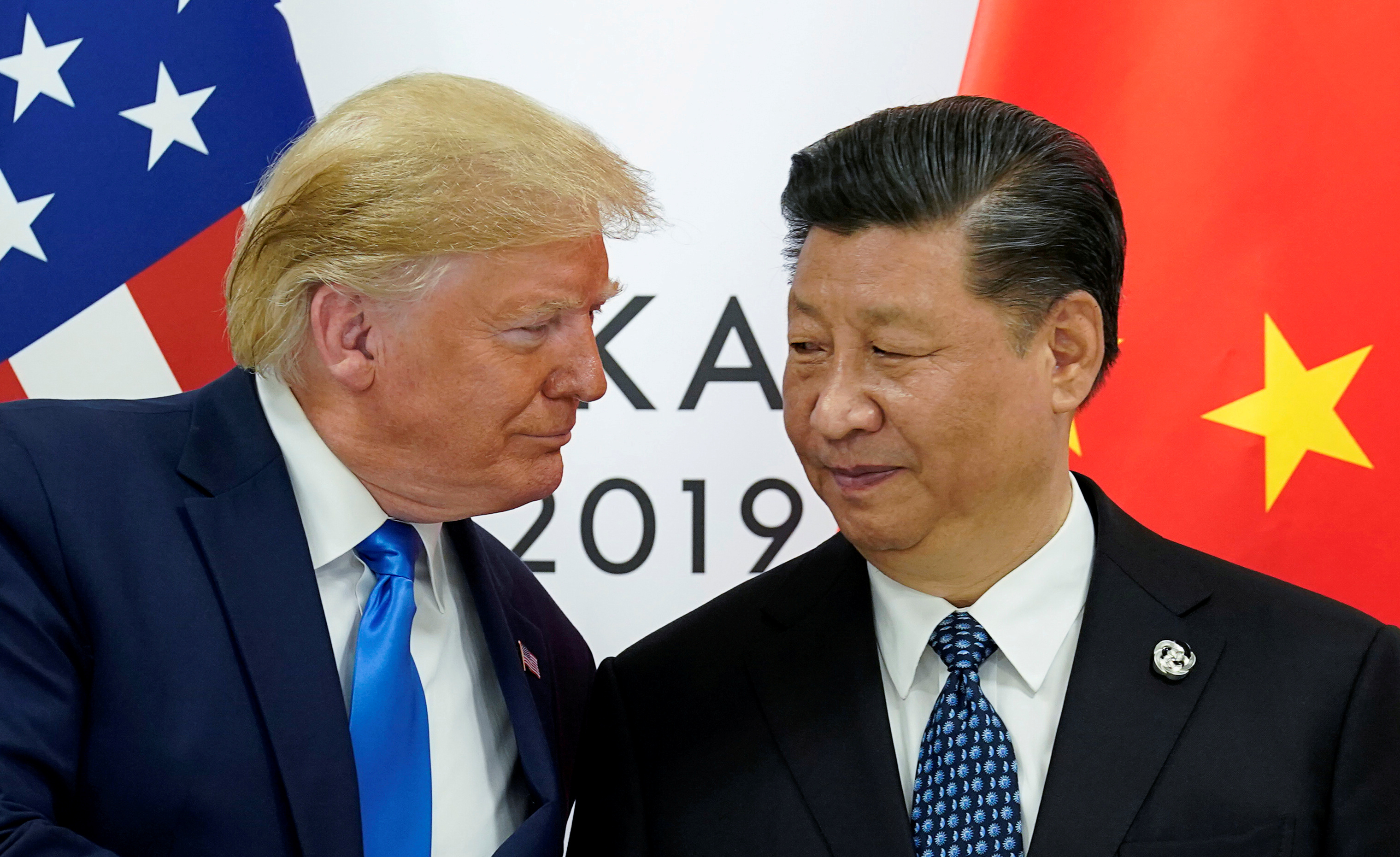FILE PHOTO: U.S. President Donald Trump meets with China's President Xi Jinping at the start of their bilateral meeting at the G20 leaders summit in Osaka, Japan, June 29, 2019. REUTERS/Kevin Lamarque