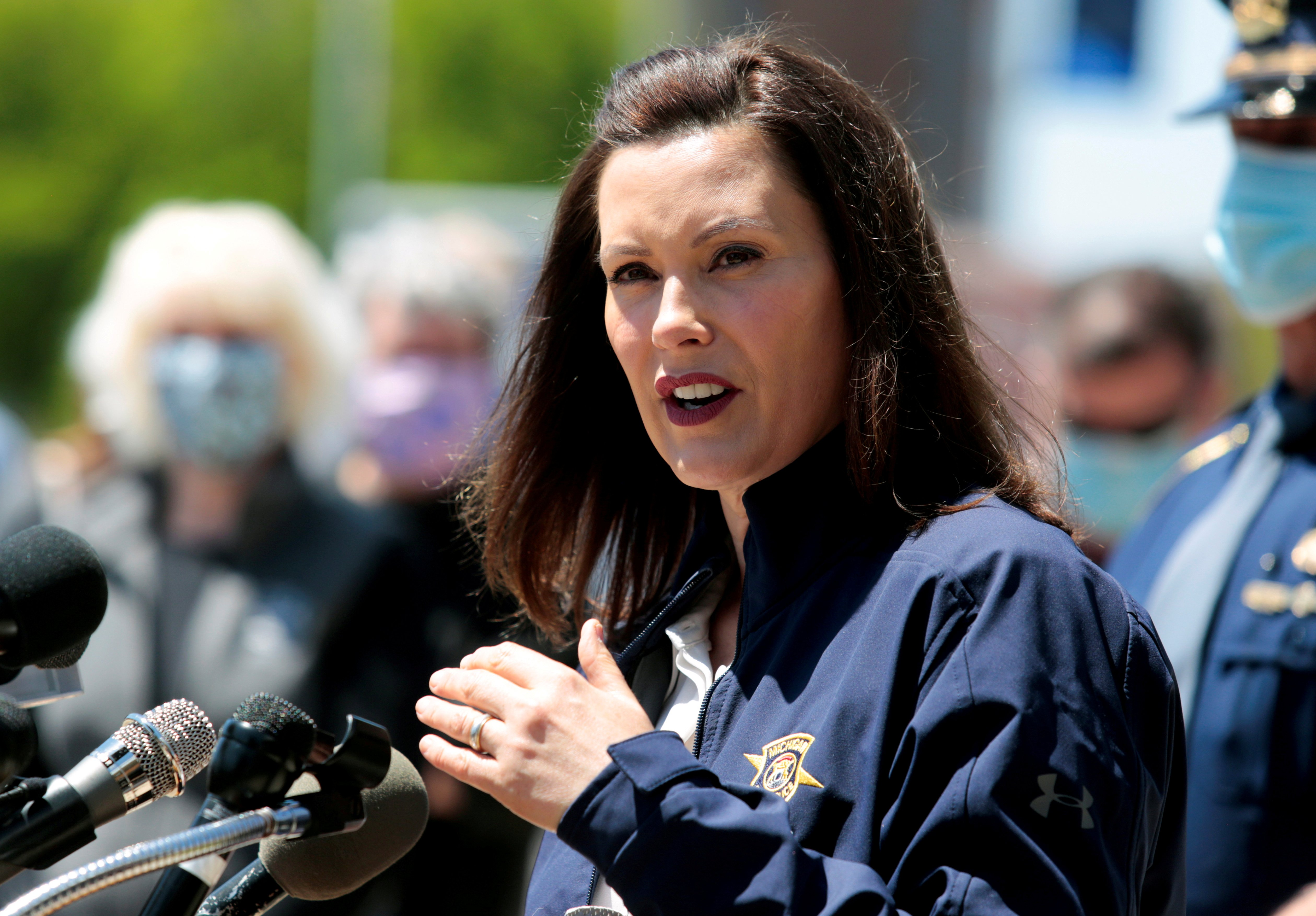 FILE PHOTO: Michigan Governor Gretchen Whitmer addresses the media about the flooding along the Tittabawassee River, after several dams breached, in downtown Midland, Michigan, U.S., May 20, 2020. REUTERS/Rebecca Cook