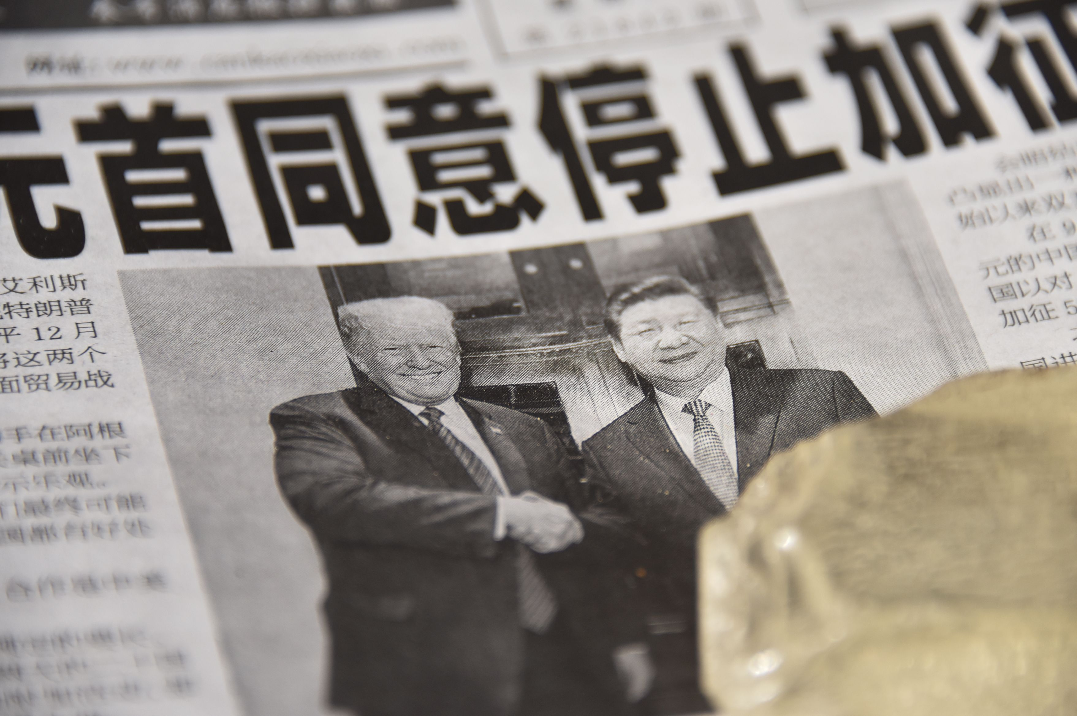 A newspaper featuring a front page story about the meeting between US President Donald Trump and Chinese President Xi Jinping as seen at a news stand in Beijing on December 3, 2018. (GREG BAKER/AFP via Getty Images)