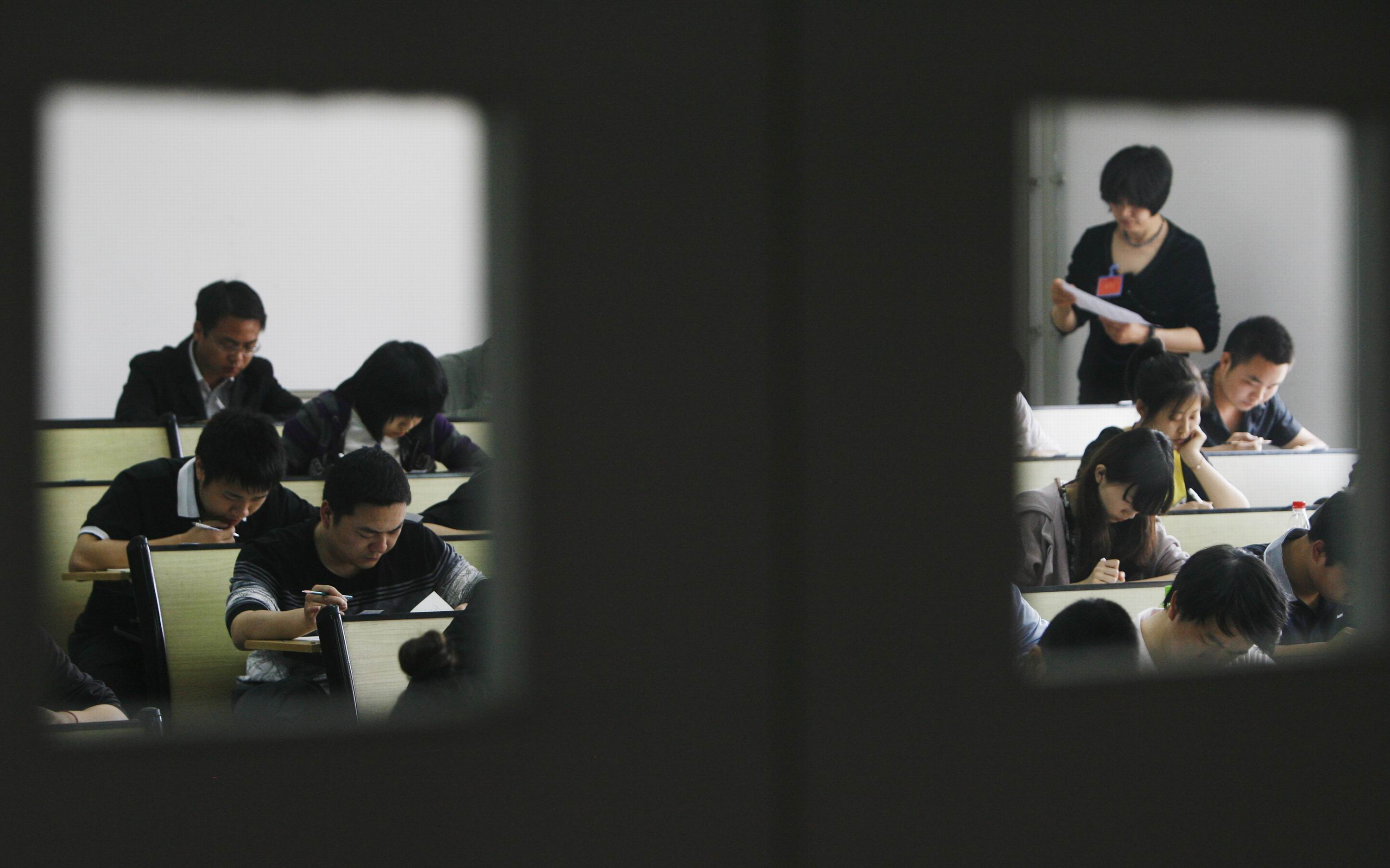 People take part in the civil service examination at Huazhong University of Science and Technology on April 24, 2011 in Wuhan, Hubei Province of China. (Photo by VCG/VCG via Getty Images)
