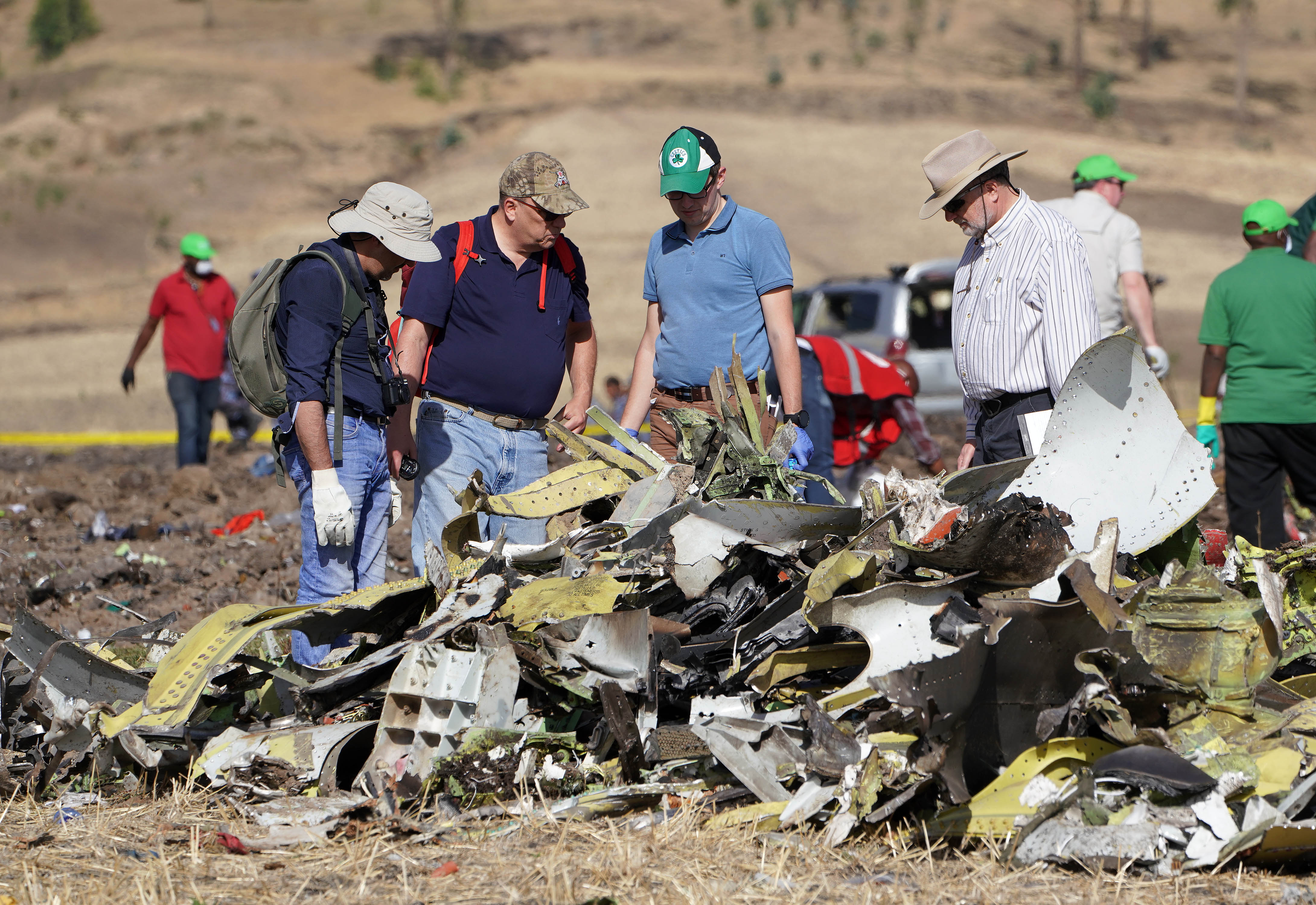 Investigators with the U.S. National Transportation and Safety Board (NTSB) look over debris at the crash site of Ethiopian Airlines Flight ET 302 on March 12, 2019 in Bishoftu, Ethiopia.. All 157 passengers and crew perished after the Ethiopian Airlines Boeing 737 Max 8 Flight came down six minutes after taking off from Bole Airport. (Photo by Jemal Countess/Getty Images)