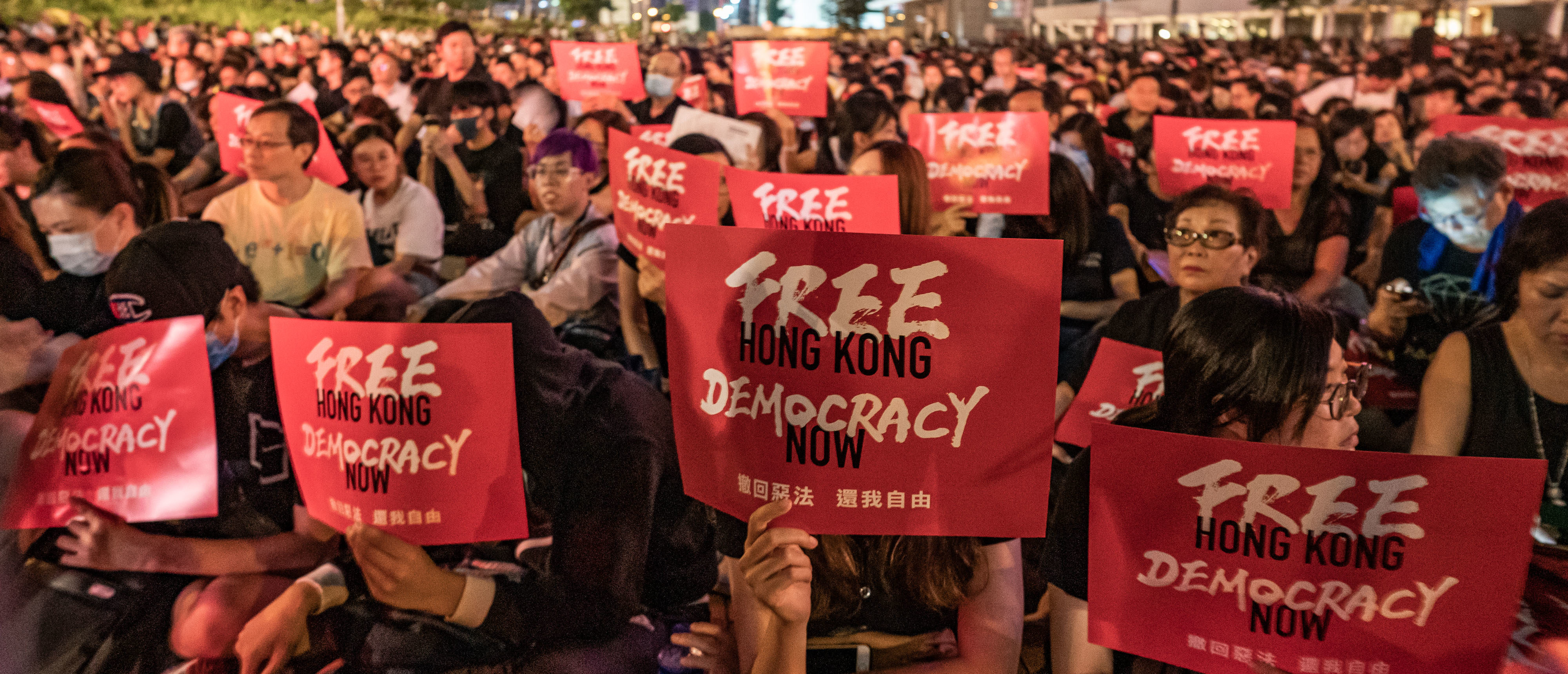 HONG KONG, HONG KONG - JUNE 26: Protesters hold placards as they take part in a rally against the extradition bill ahead of 2019 G20 Osaka summit at Edinburgh Place in Central district on June 26, 2019 in Hong Kong, China. Leaders from the Group of 20 nations are scheduled to gather this week for the G20 summit in Osaka, Japan. (Photo by Anthony Kwan/Getty Images)