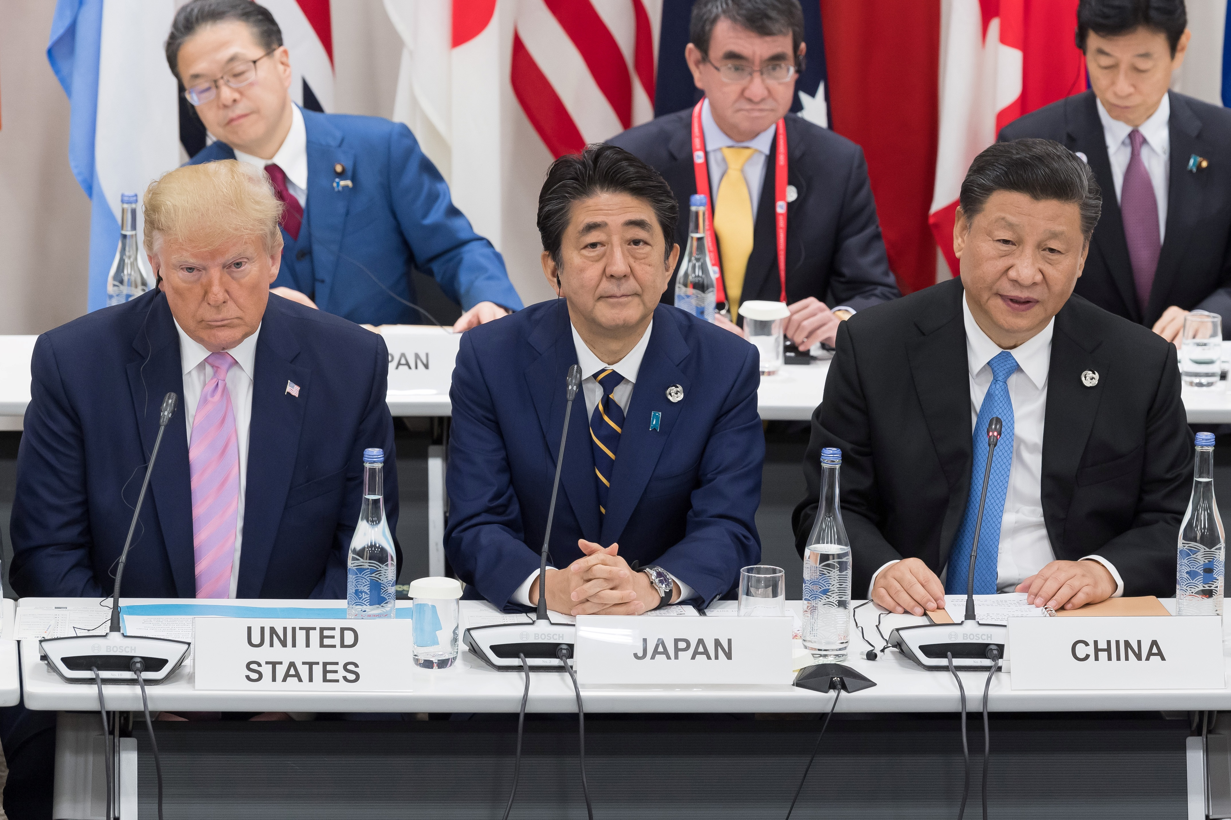 US President Donald Trump (L) sits with Japan's Prime Minister Shinzo Abe (C) and China's President Xi Jinping as they attend a meeting on the digital economy at the G20 Summit in Osaka on June 28, 2019. (JACQUES WITT/AFP via Getty Images)