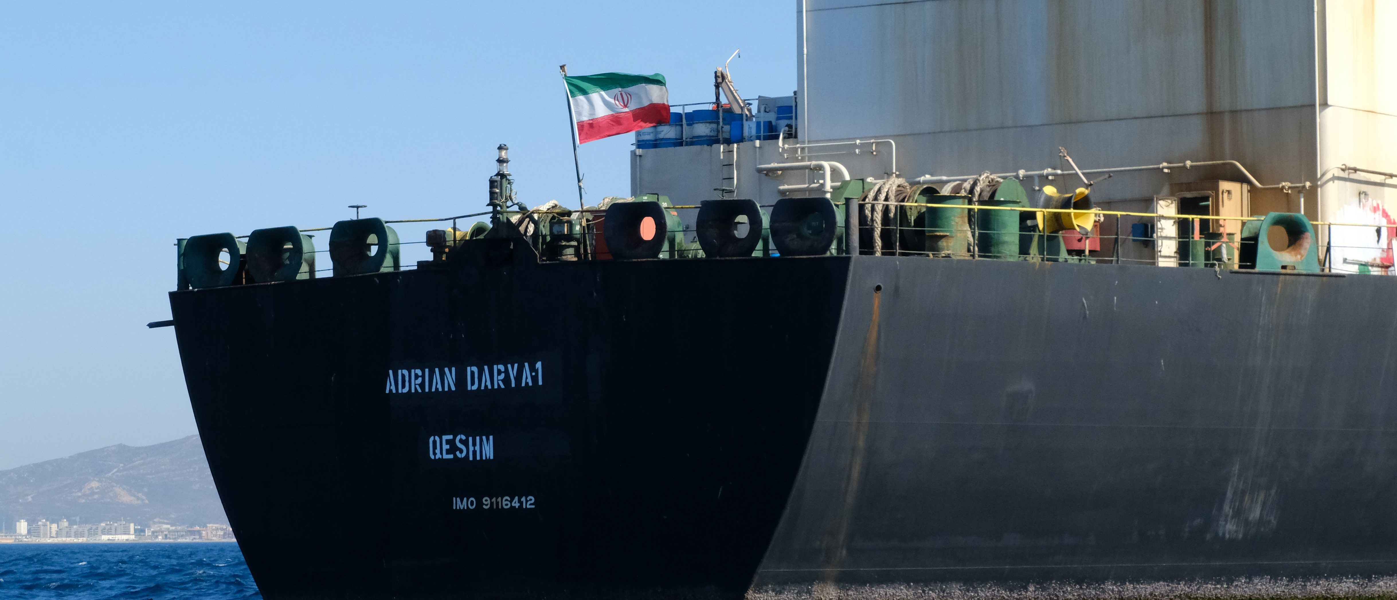 TOPSHOT - An Iranian flag flutters on board the Adrian Darya oil tanker, formerly known as Grace 1, off the coast of Gibraltar on August 18, 2019. - Gibraltar rejected a US demand to seize the Iranian oil tanker at the centre of a diplomatic dispute as it prepared to leave the British overseas territory after weeks of detention. (Photo by Johnny BUGEJA / AFP) (Photo by JOHNNY BUGEJA/AFP via Getty Images)