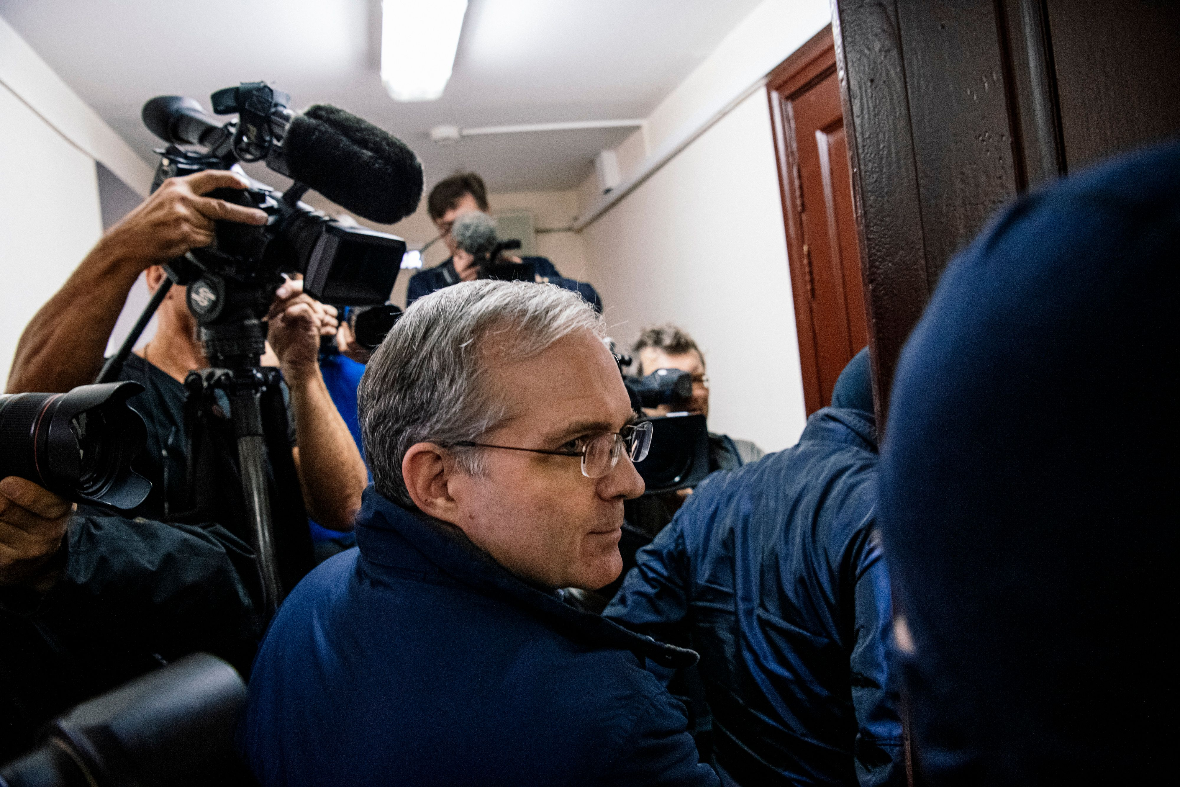 US-British Paul Whelan (C), a former US Marine accused of espionage and arrested in Russia in December 2018, is escorted for a hearing to decide to extend his detention at the Lefortovo Court in Moscow on October 24, 2019. (Photo by Dimitar Dilkoff/AFP via Getty Images)