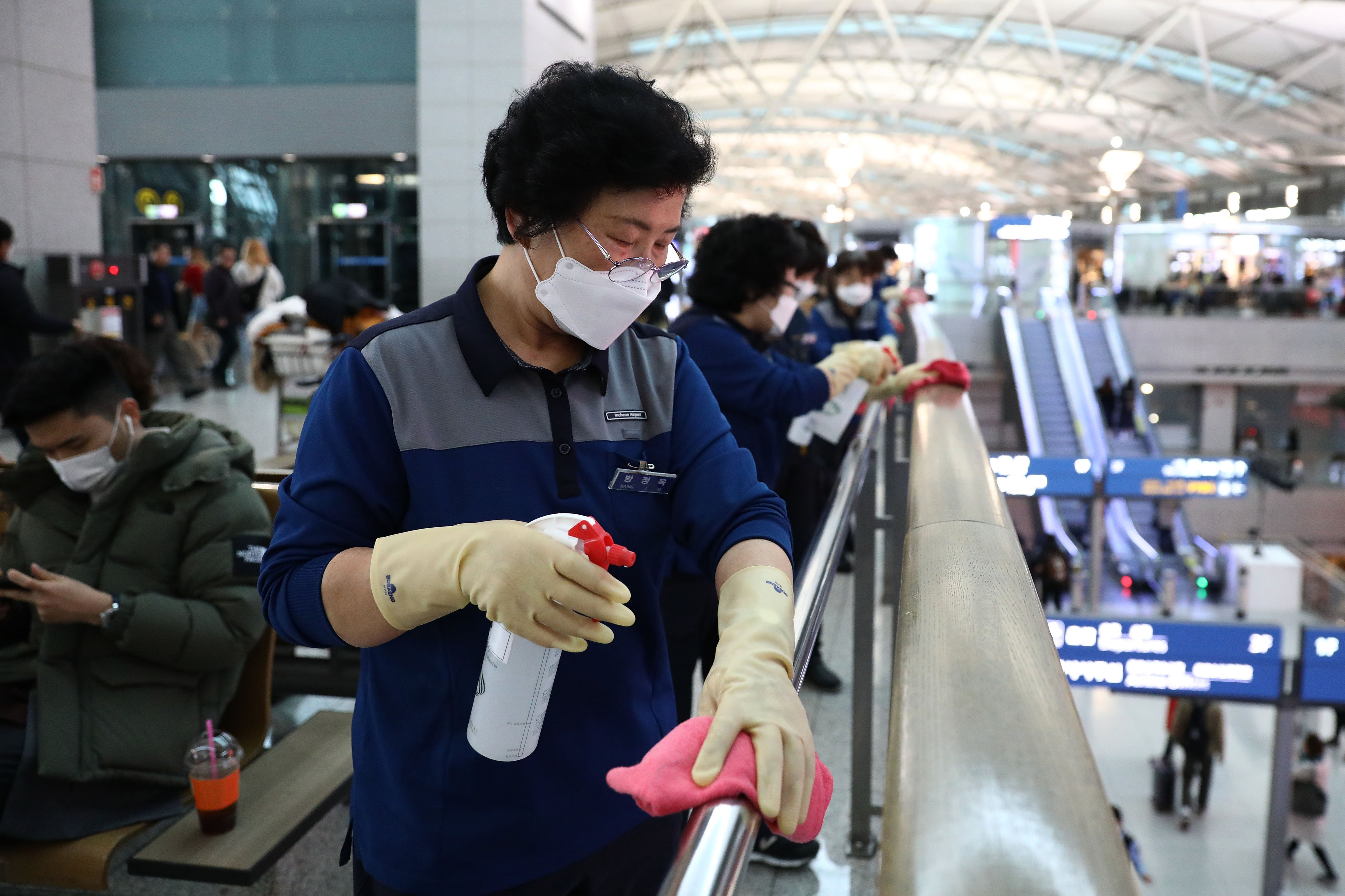Disinfection workers wearing masks and spray anti-septic solution at the Incheon International Airport on January 27, 2020 in Incheon, South Korea. South Korea confirmed its fourth case of the deadly coronavirus which emerged last month in the city of Wuhan in China and South Korea is one of the most popular foreign travel destinations for Chinese tourists. (Photo by Chung Sung-Jun/Getty Images)