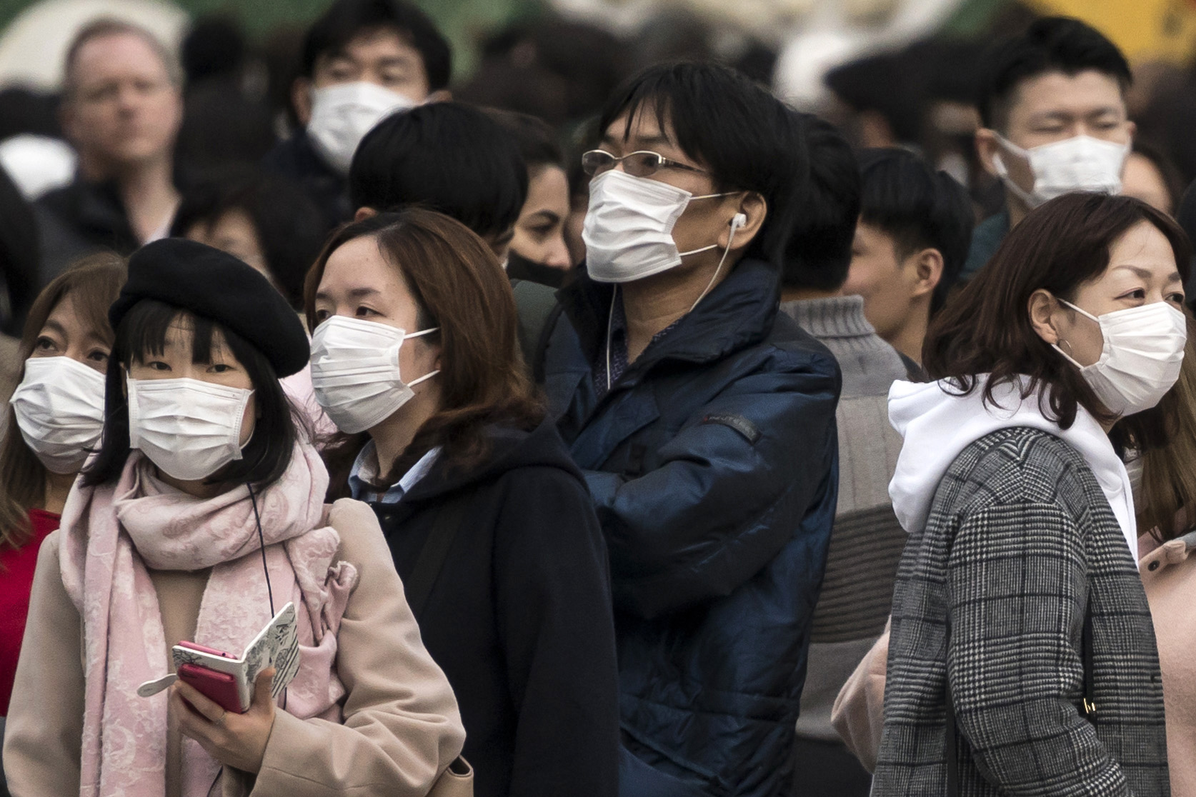 People wearing masks wait to cross a road in the Shibuya district on February 02, 2020 in Tokyo, Japan. Japan reported 20 cases of Wuhan coronavirus infections as the number of those who have died from the virus, known as 2019-nCoV, in China climbed to over 300 and cases have been reported in other countries including the United States, Canada, Australia, Japan, South Korea, India, the United Kingdom, Germany, France, and several others. (Photo by Tomohiro Ohsumi/Getty Images)