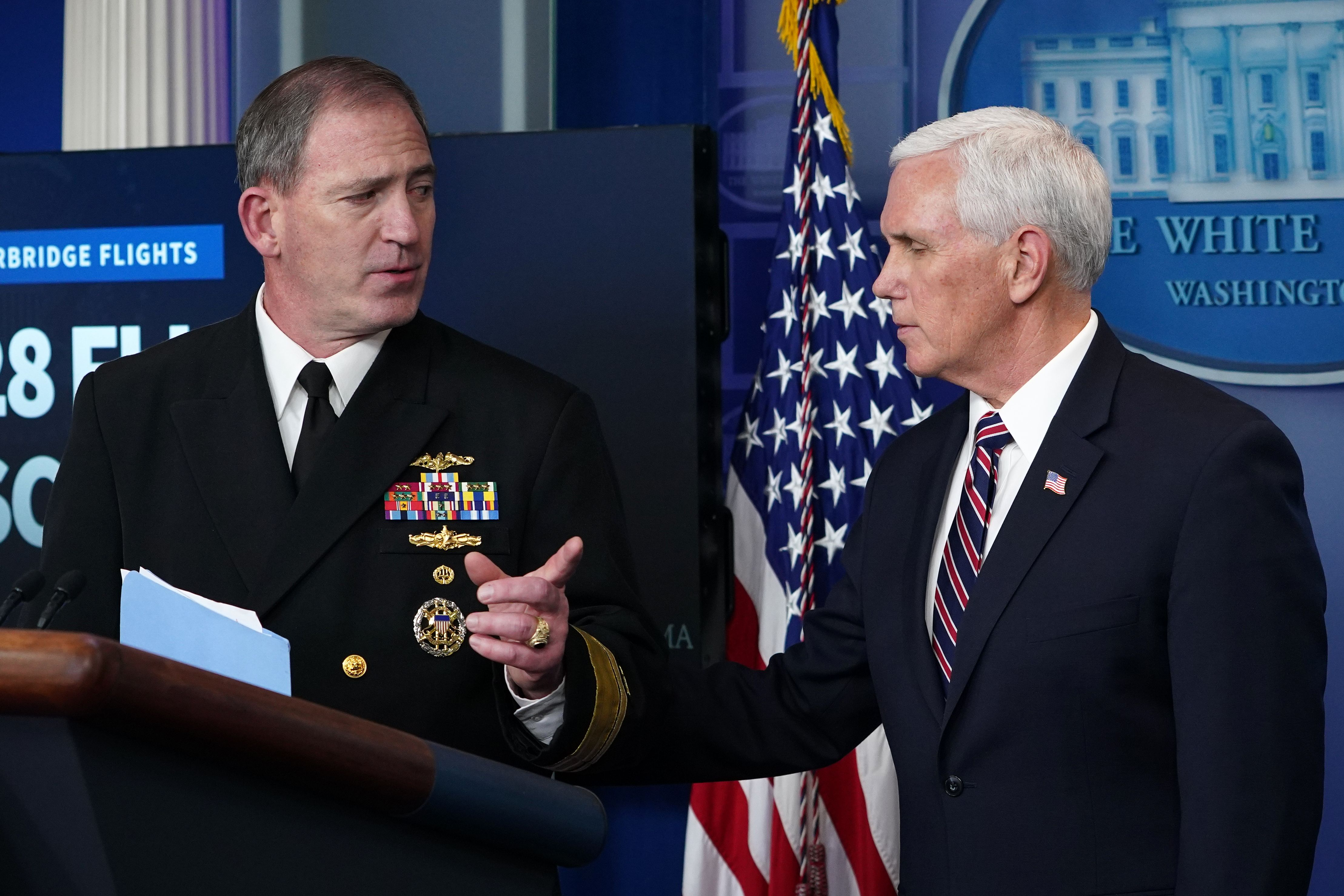 Rear Adm. John Polowczyk (L) and US Vice President Mike Pence speak during the daily briefing on the novel coronavirus, COVID-19, in the Brady Briefing Room at the White House on April 2, 2020, in Washington, DC. (Photo by MANDEL NGAN/AFP via Getty Images)